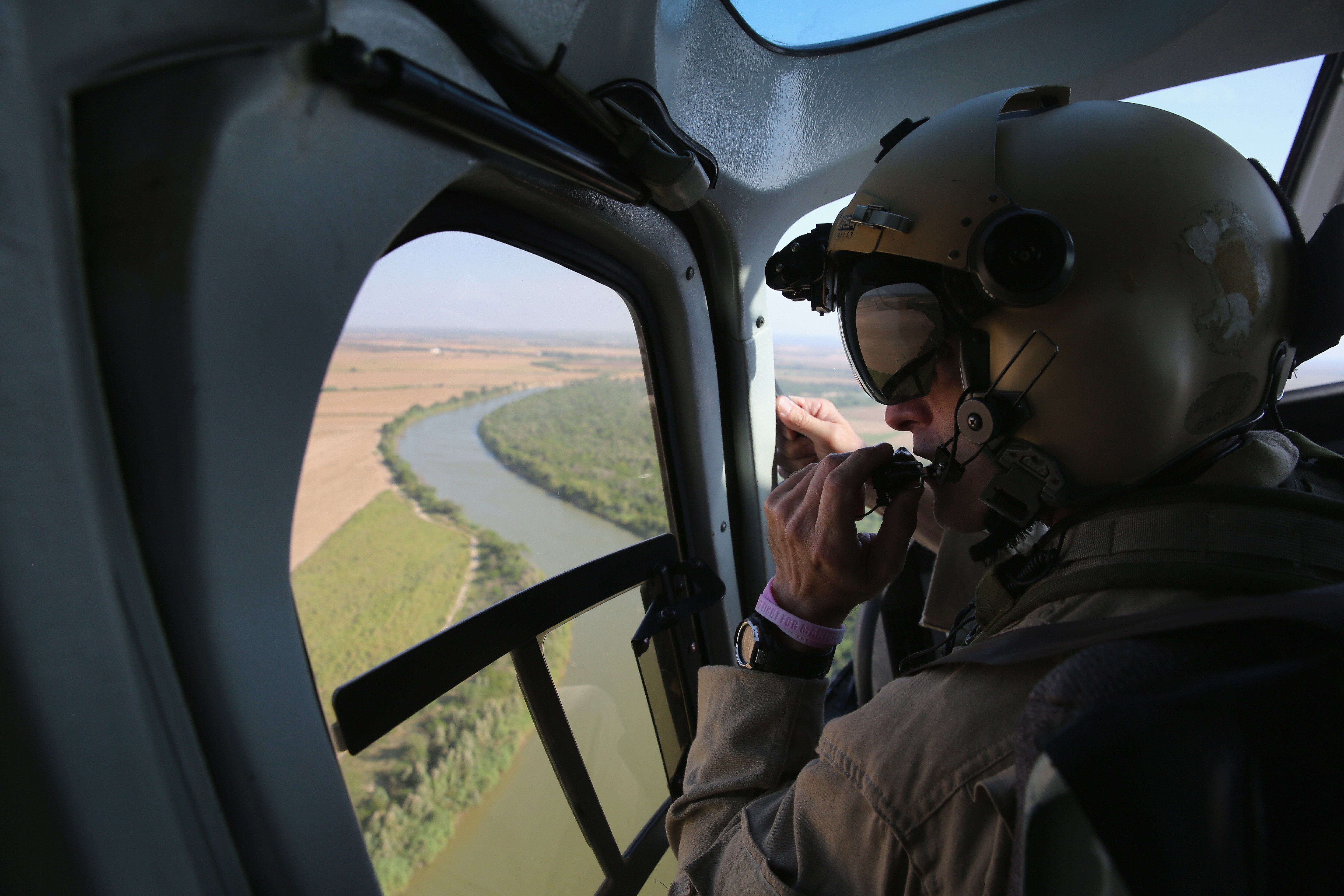 A U.S. Office of Air and Marine helicopter patrols over the Rio Grande at the U.S.-Mexico border in McAllen, Texas on July 21, 2014.