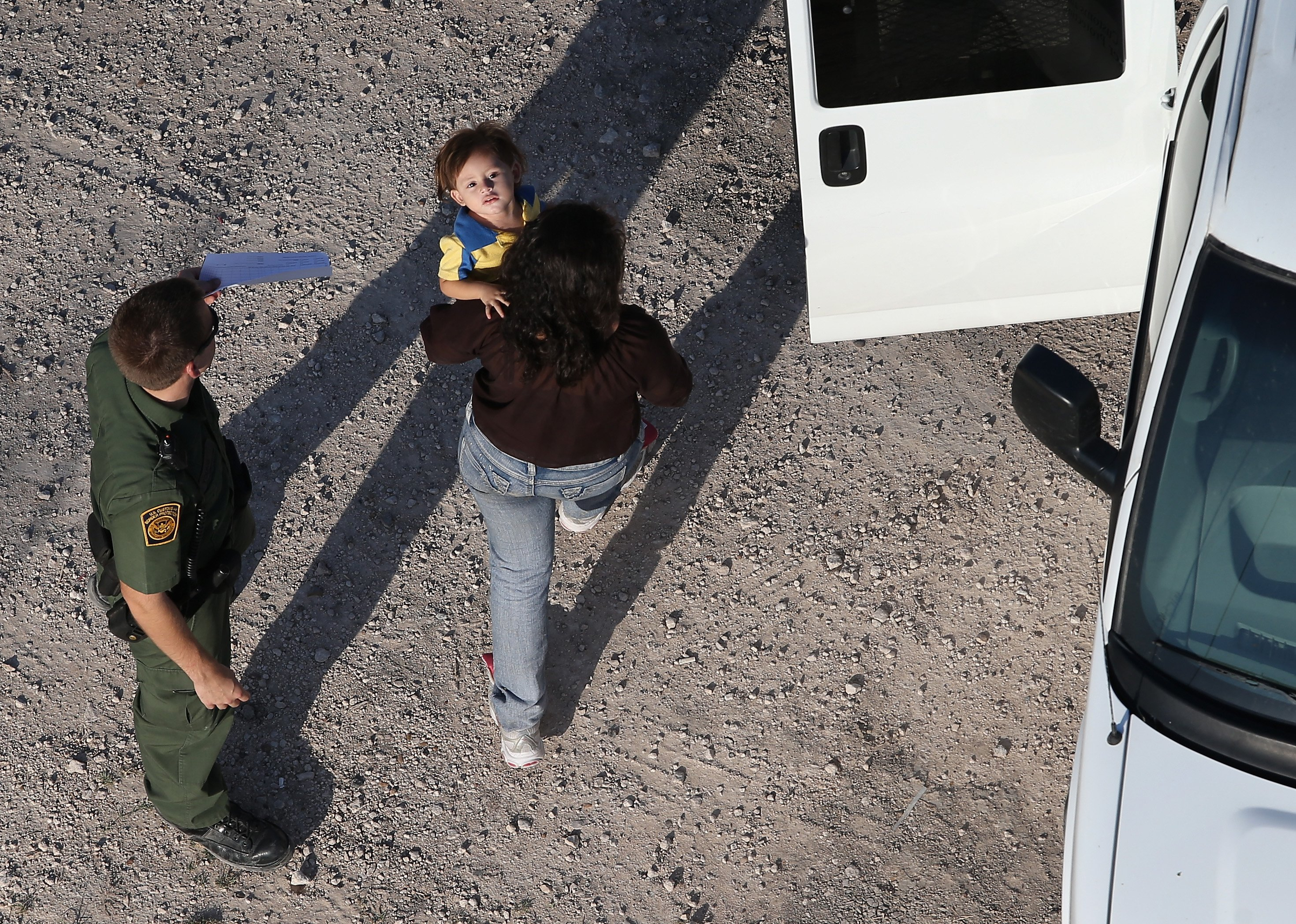 Border Patrol agents take undocumented immigrant families into custody in McAllen, Texas on July 21, 2014.