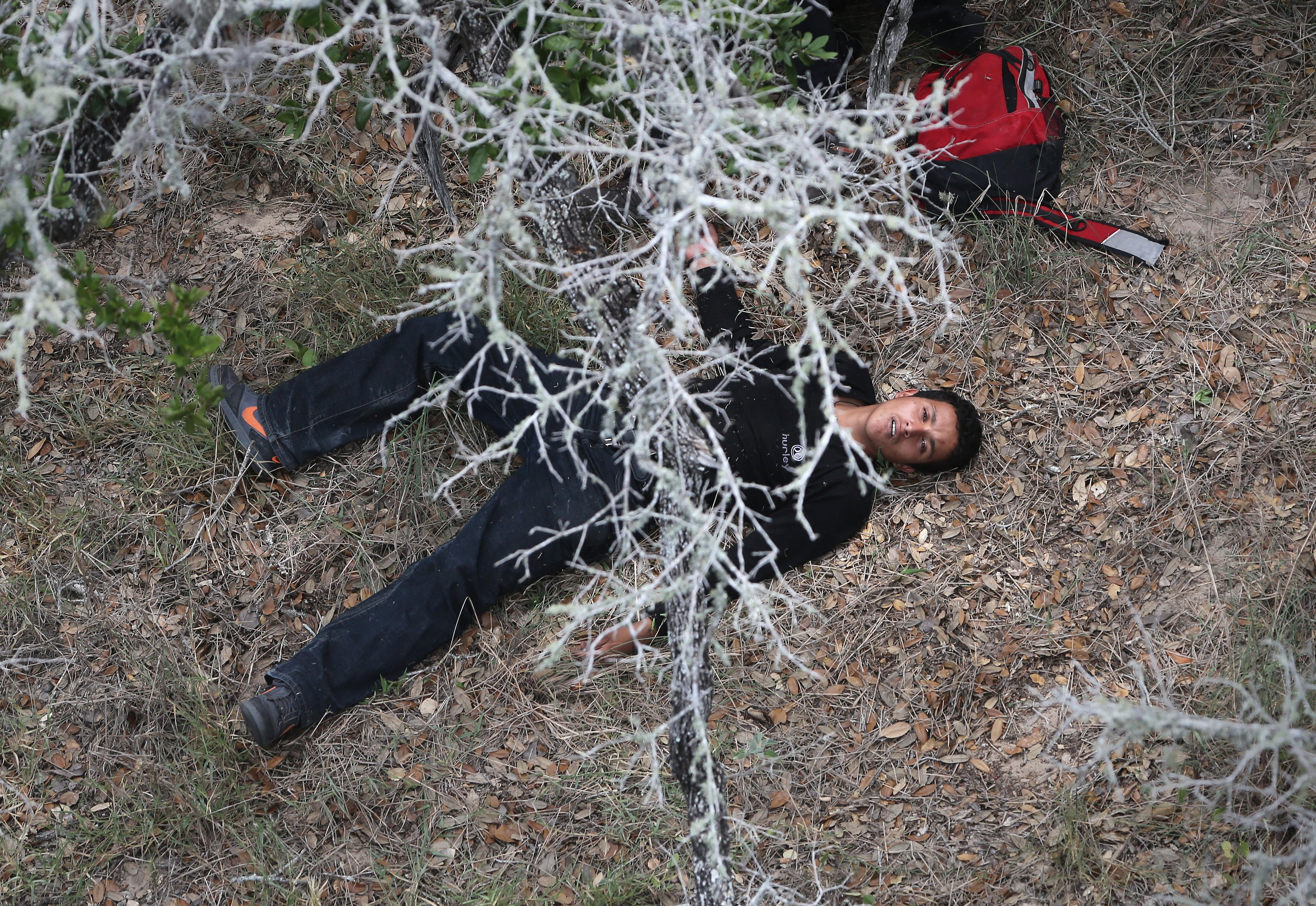 An undocumented immigrant awaits medical attention by U.S. Border Patrol agents some 60 miles north of the U.S.-Mexico border near Falfurrias, Texas on July 23, 2014.