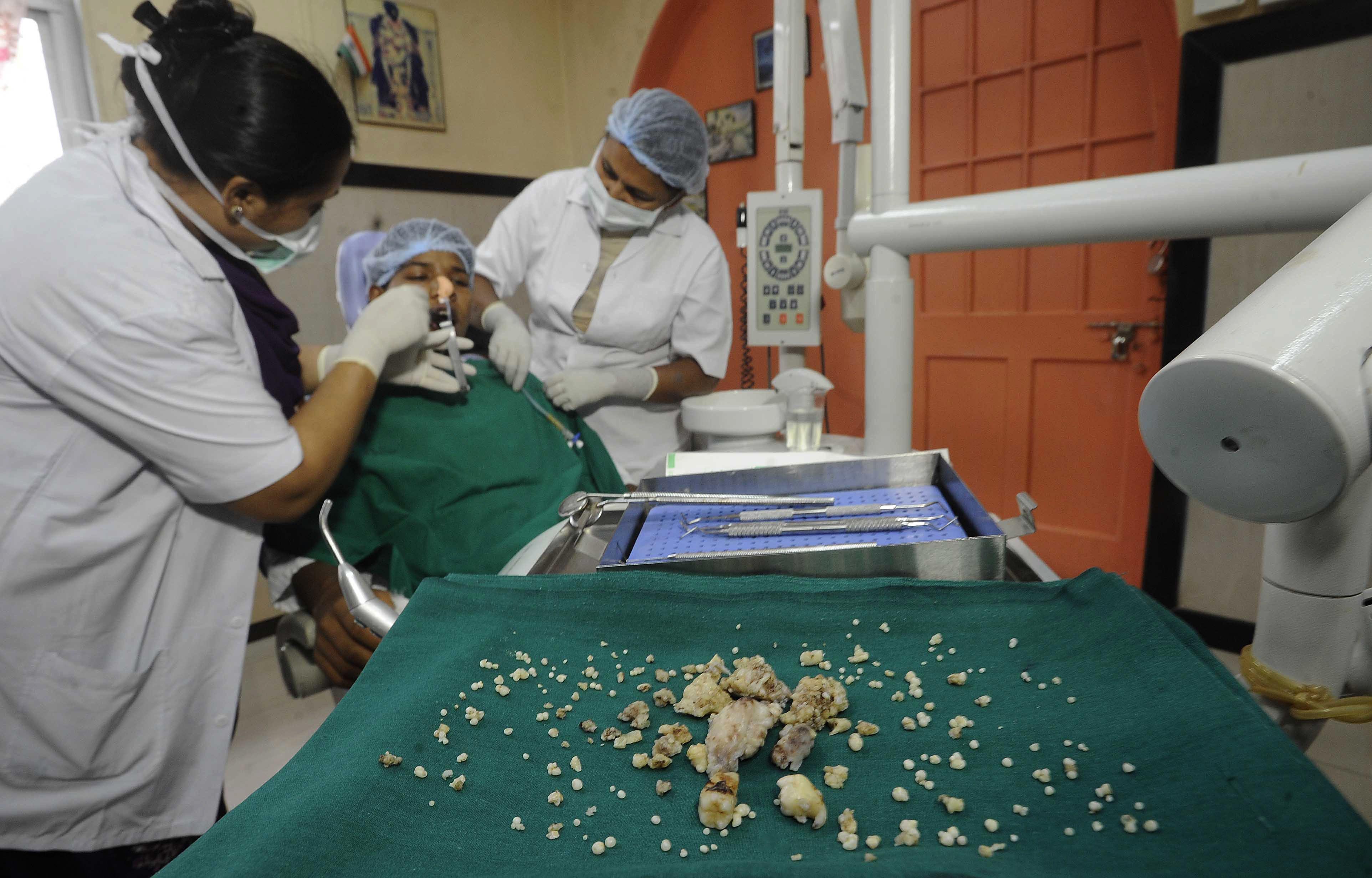 Indian dentists operate on Ashik Gavai at JJ Hospital in Mumbai on July 22, 2014,