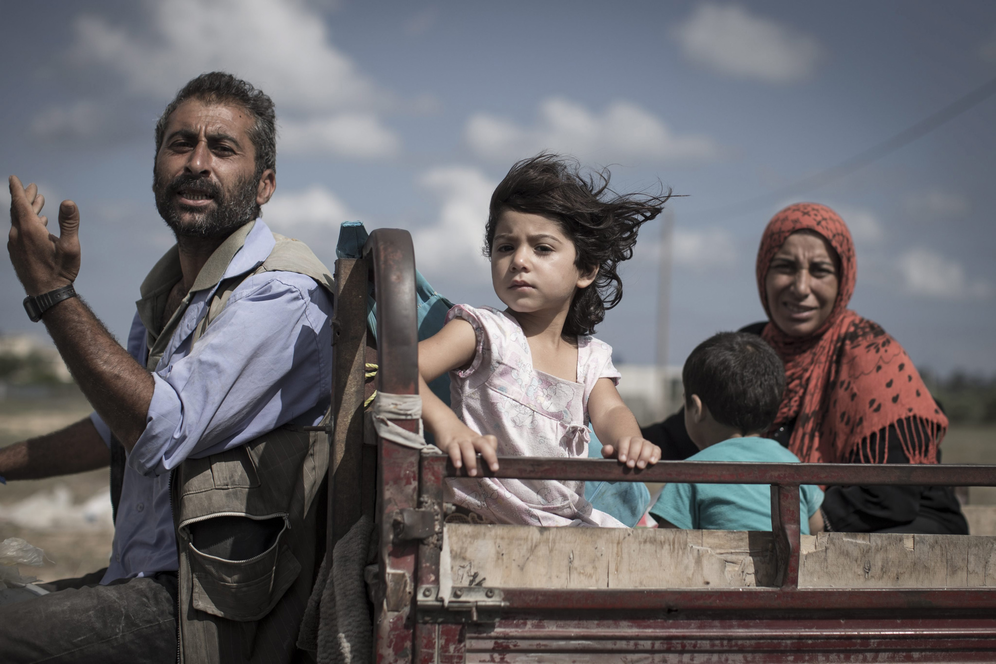 A Palestinian family who fled their homes is en route to seek shelter in a UN school in Khan Younis, central Gaza Strip, 18 July 18, 2014.