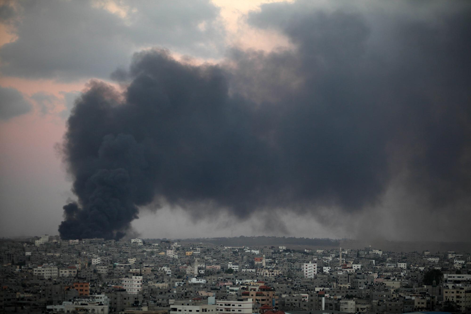 Smoke from an Israeli strike rises over the Gaza Strip, July 25, 2014.