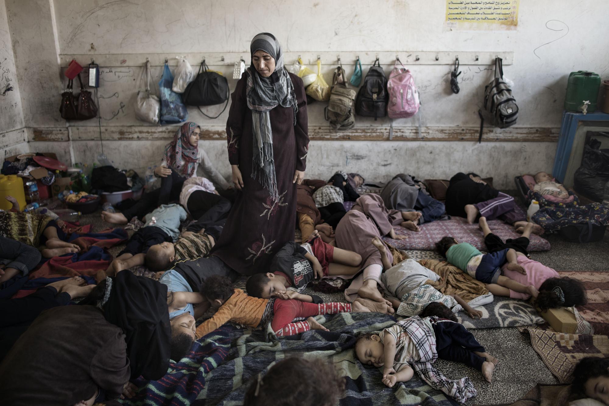 Displaced Palestinians from Beit Hanoun sleep inside the UNRWA school in Jabalia, July 23, 2014.