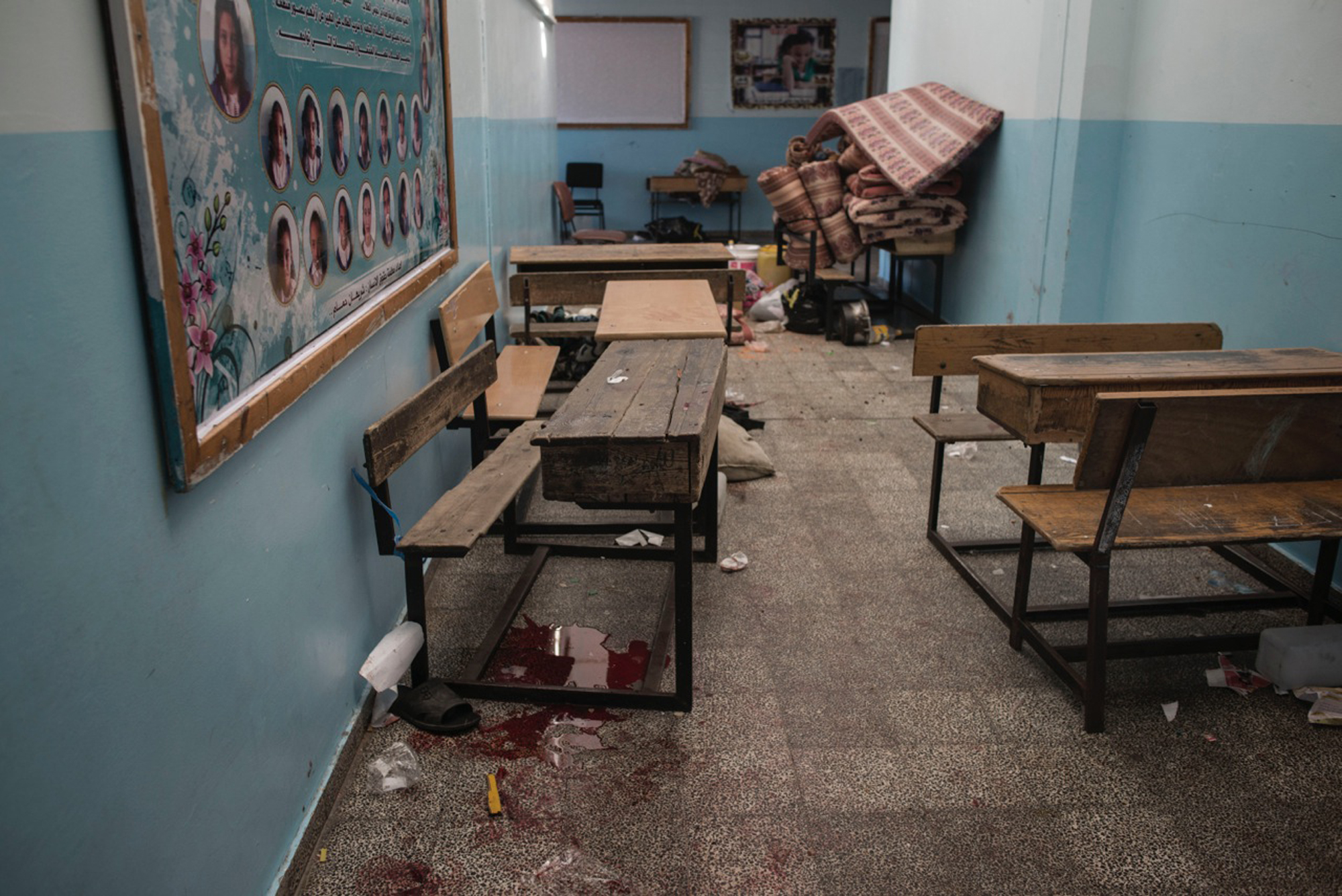 Blood stains of displaced Palestinians are seen inside the UNRWA school in Beit Hanoun after it had been hit, Gaza Strip, July 24, 2014.
