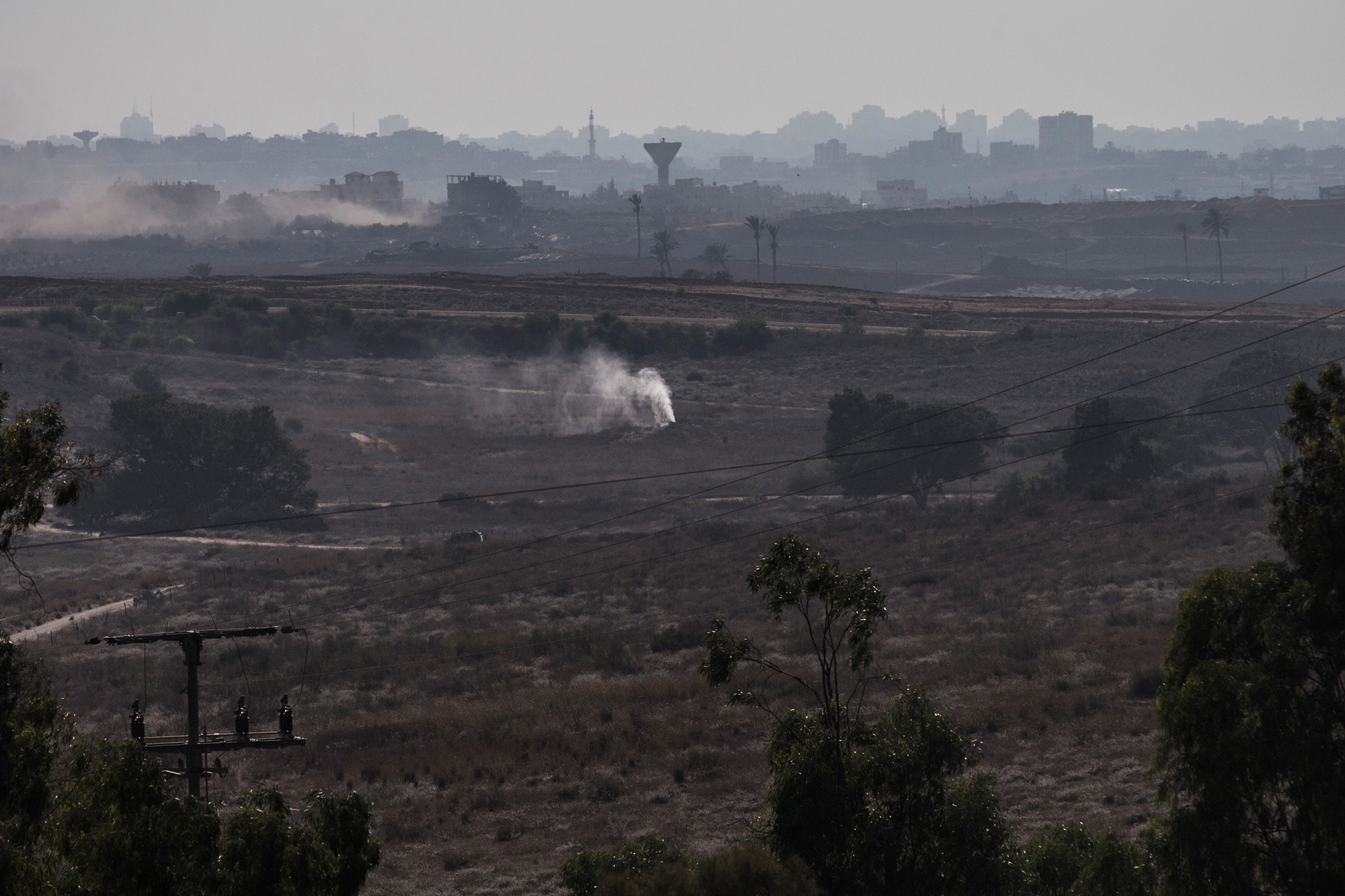 Smoke pours out of the ground due to an alleged campaign by the Israeli military to fill tunnels originating in Gaza with smoke to discover entrances into Israel on July 23, 2014 near Sderot, Israel.