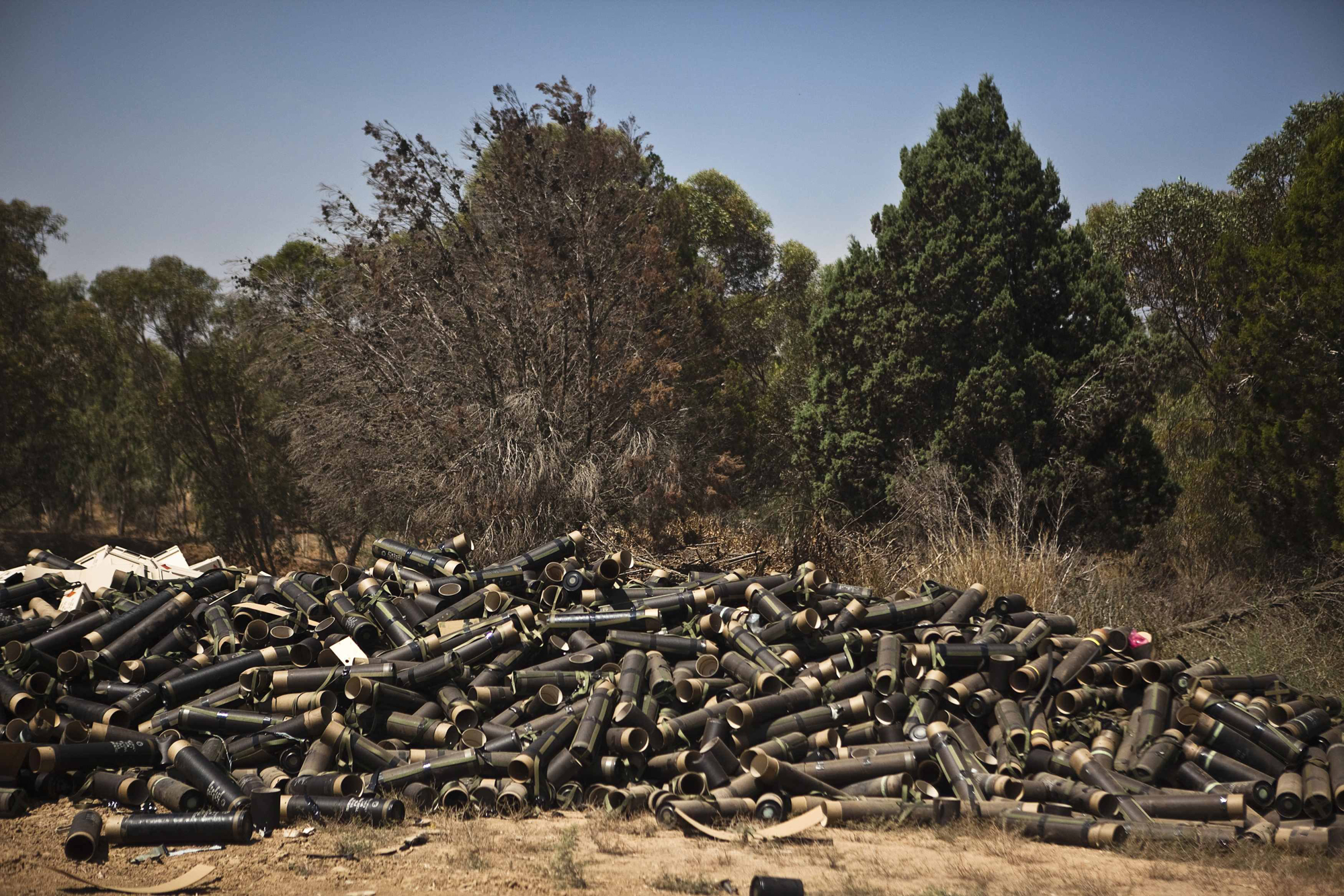 Mortar cases are piled at a military staging area near the border with the Gaza Strip, July 24, 2014.