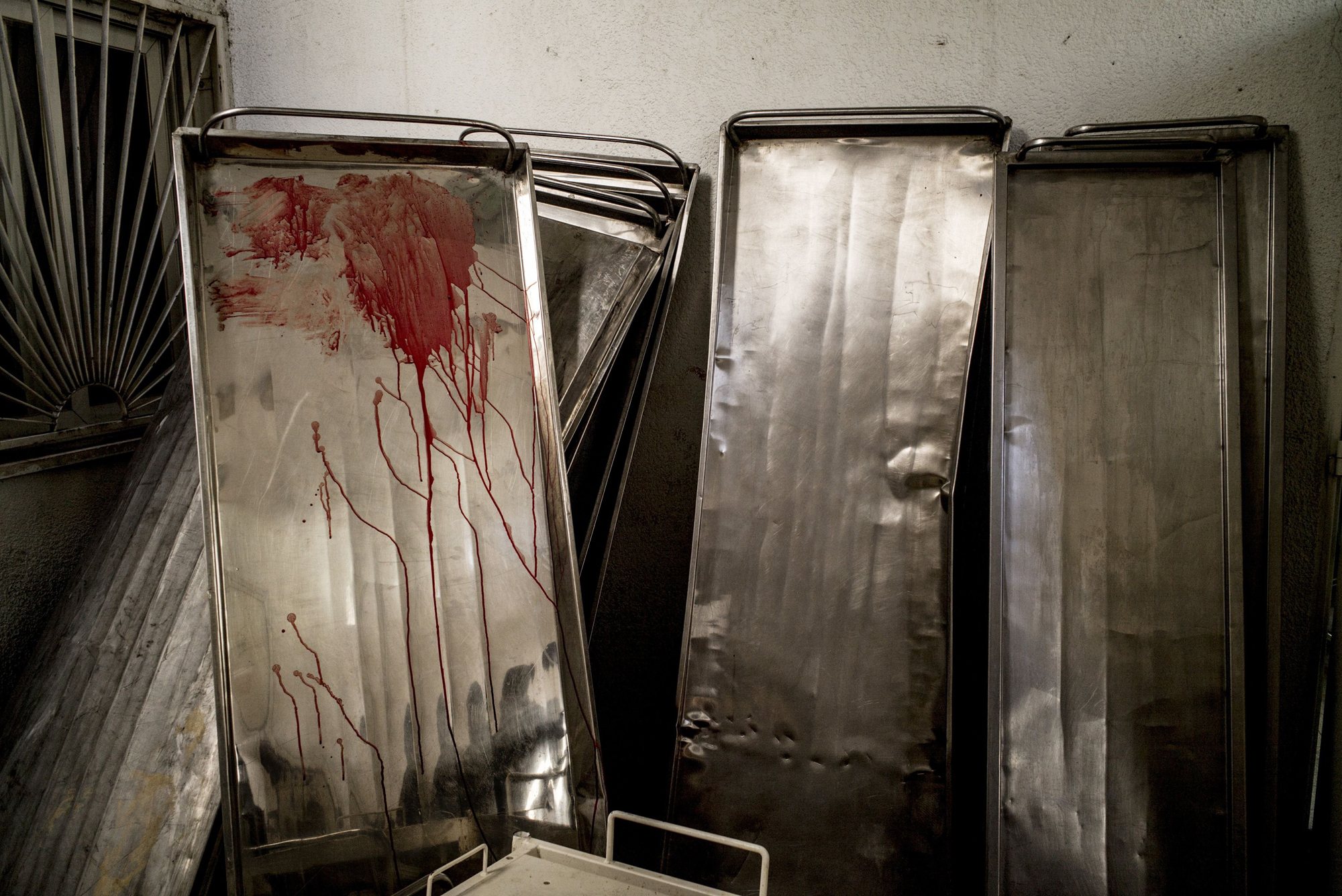 Gurneys are seen piled up outside the morgue at the Kamal Adwan hospital in Beit Lahia in the northern Gaza Strip on July 30, 2014.