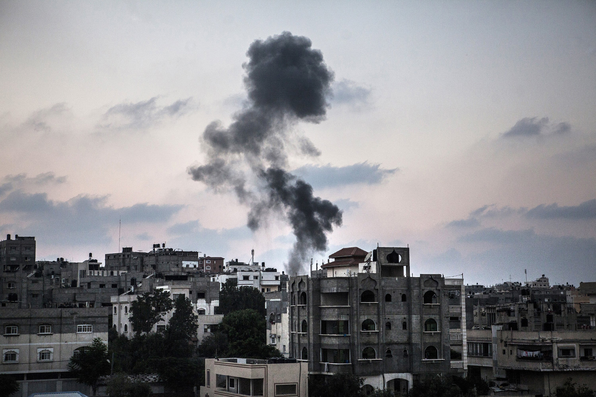 Smoke from Israeli strikes rises over Gaza City, in the Gaza Strip, July 21, 2014.