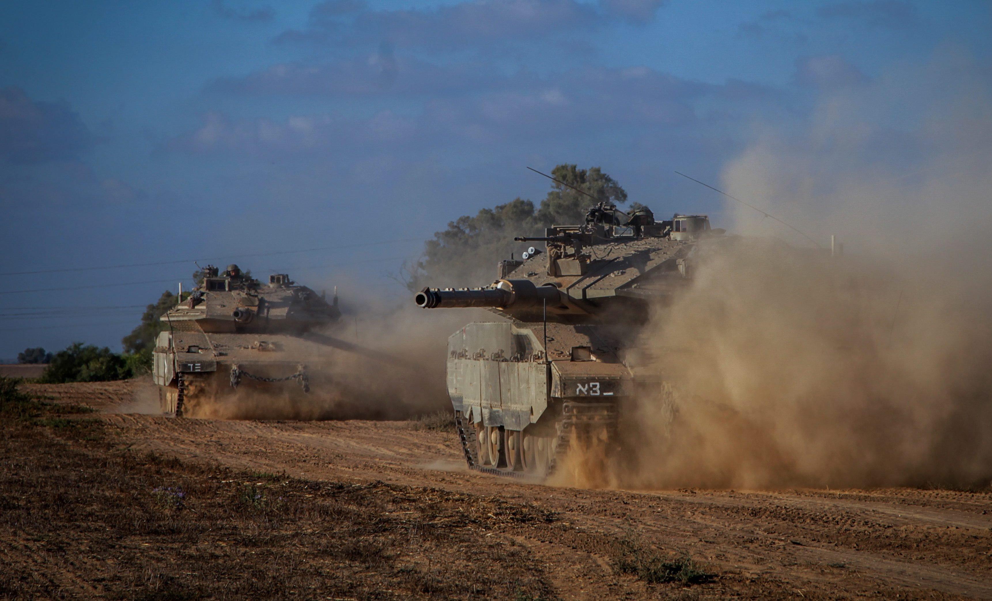 Israeli Markava tanks heading toward the Israeli-Gaza border early on July 17, 2014.
