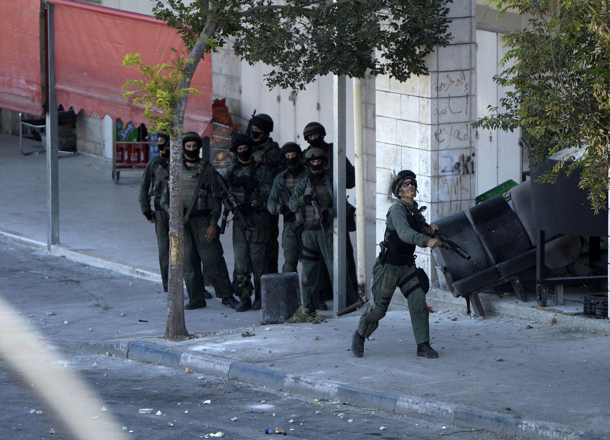 Israeli troops in the Shuafat suburb of Jerusalem, July 2.