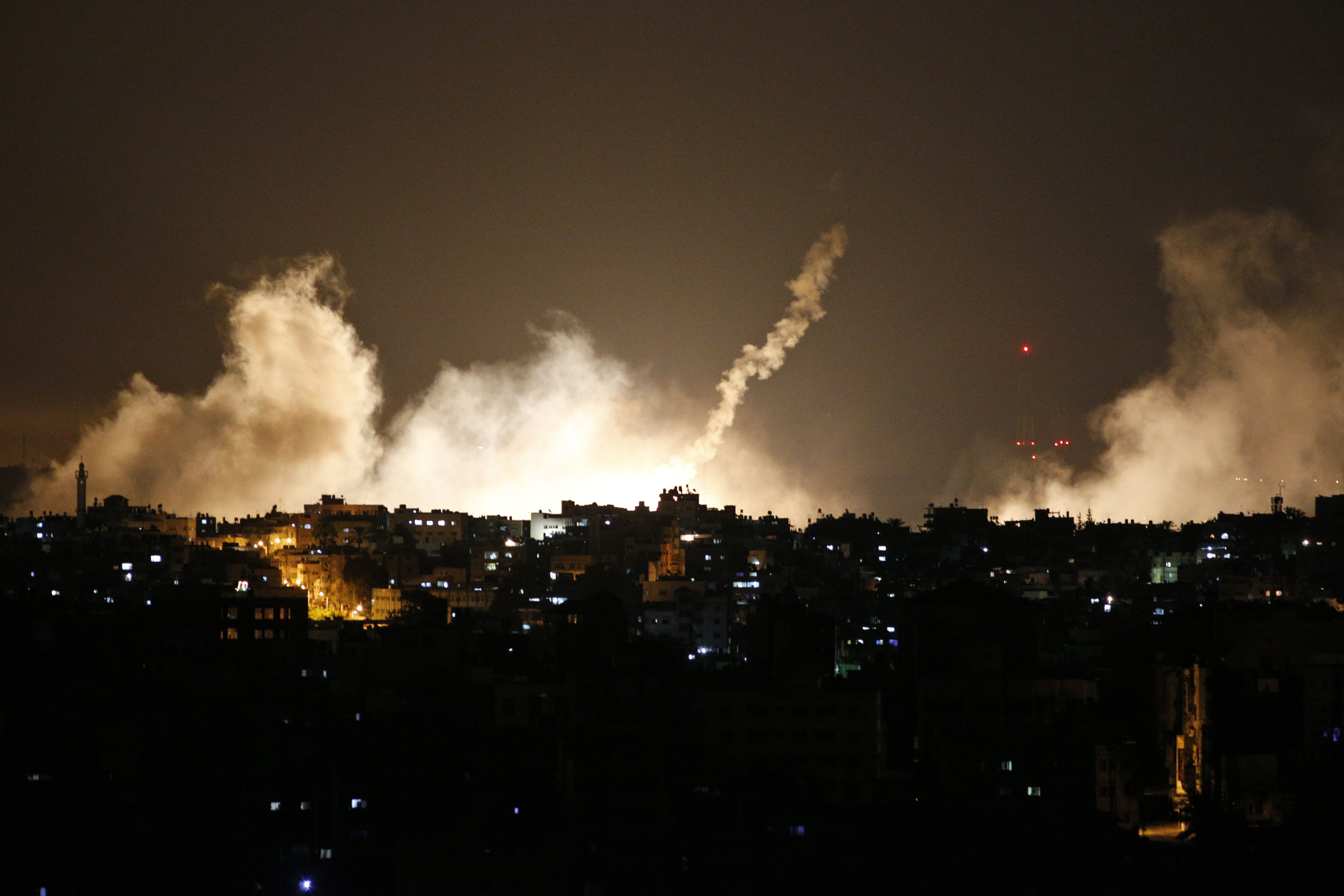 Smoke from flares rises in the sky in Gaza City, in the northern Gaza Strip on July 17, 2014.
