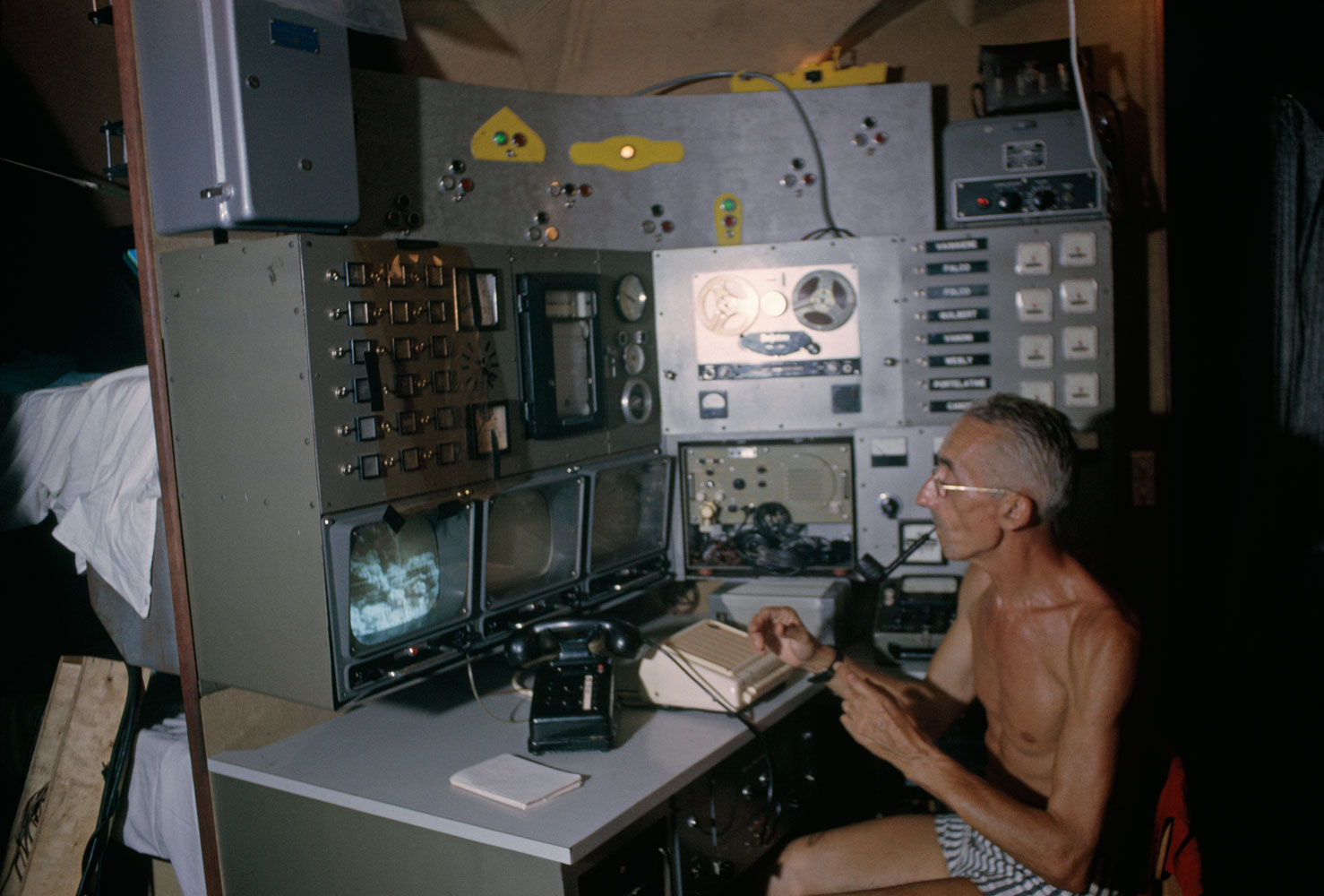 Jacques Cousteau works at an audio-visual machine during the Conshelf II Expedition.