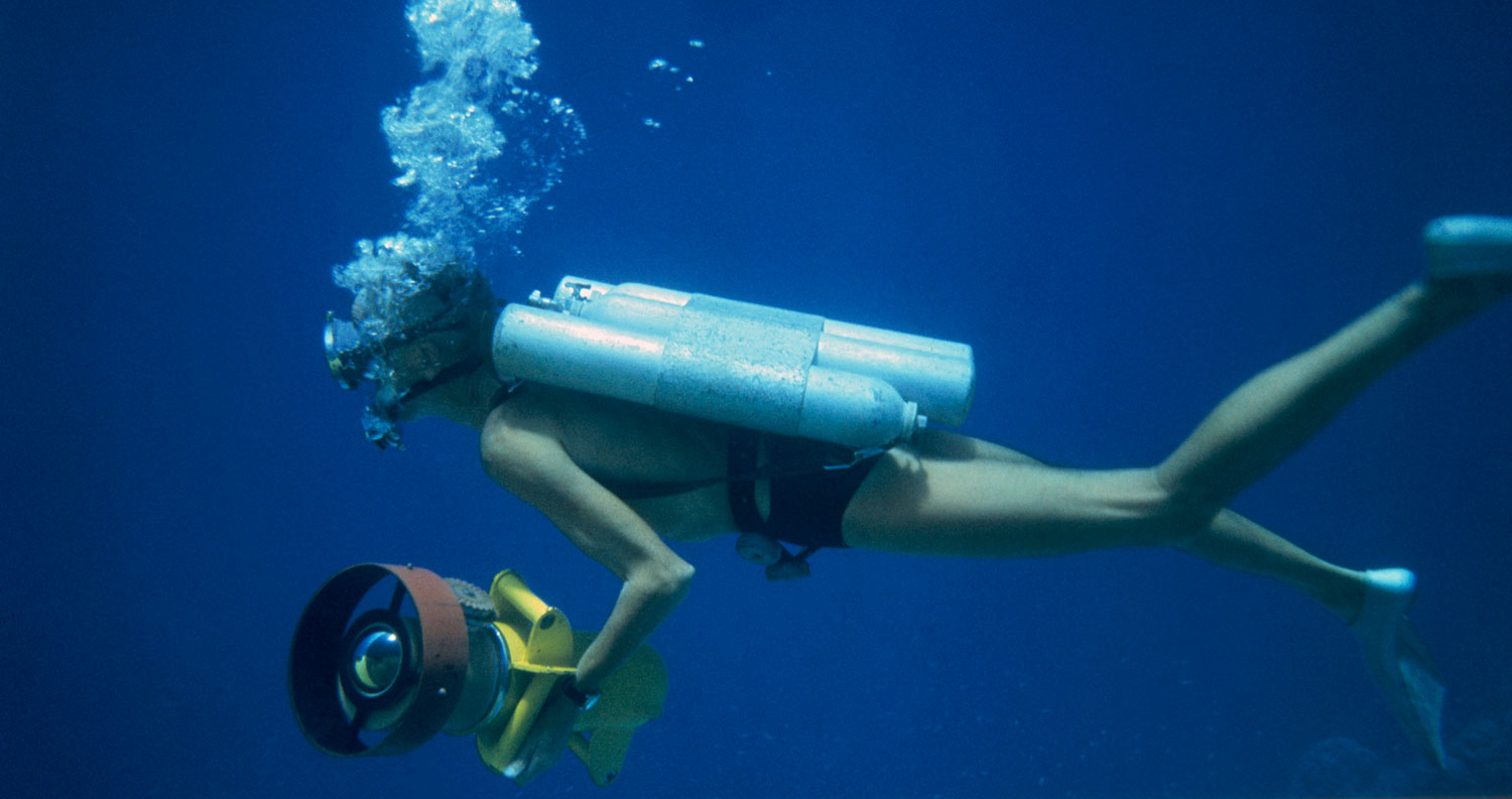 Captain Jacques Cousteau explores the water surrounding the Conshelf II submersible.