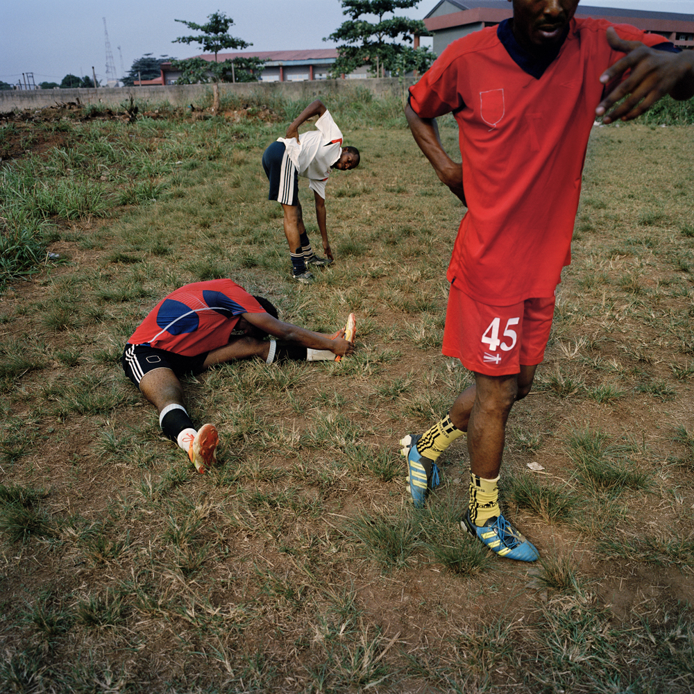 Adegeye, a former professional Nigerian soccer player, leads members of the Freedom Foundation Apostolic Revival International Ministries (FARIM) soccer team through stretching exercises at the Government Technical College in February 2014 in Ikorodu, Nigeria.
