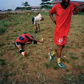 Adegeye, a former professional Nigerian footballer, leads members of the Freedom Foundation Apostolic Revival International Ministries (FARIM) soccer team through stretching exercises at the Government Technical College in February 2014 in Ikorodu, Nigeria.