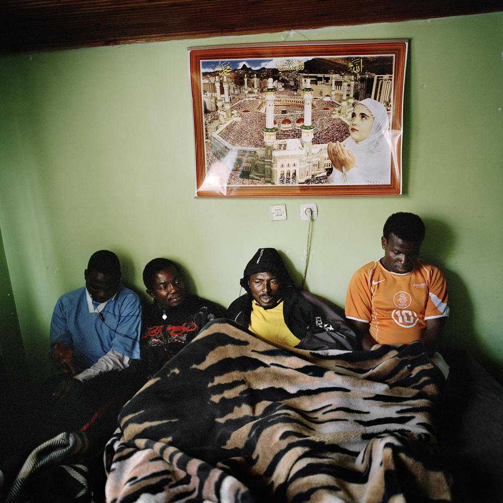 Sodiq, Adegeye and Akeem sit in the bed that they used to share with three other soccer players in the small studio apartment that they lived in April 2011 in the Kurtulus neighborhood of Istanbul.