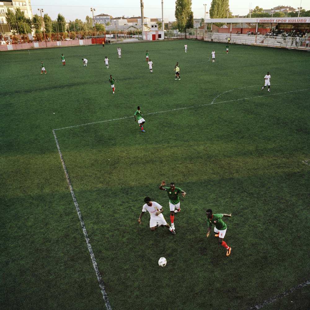Guinea and Uganda play against each other in the semi-final match of the Africa Community Cup that's held every year on the run-down Feriköy pitch in the Kurtulus neighborhood on August 4, 2012 in Istanbul.