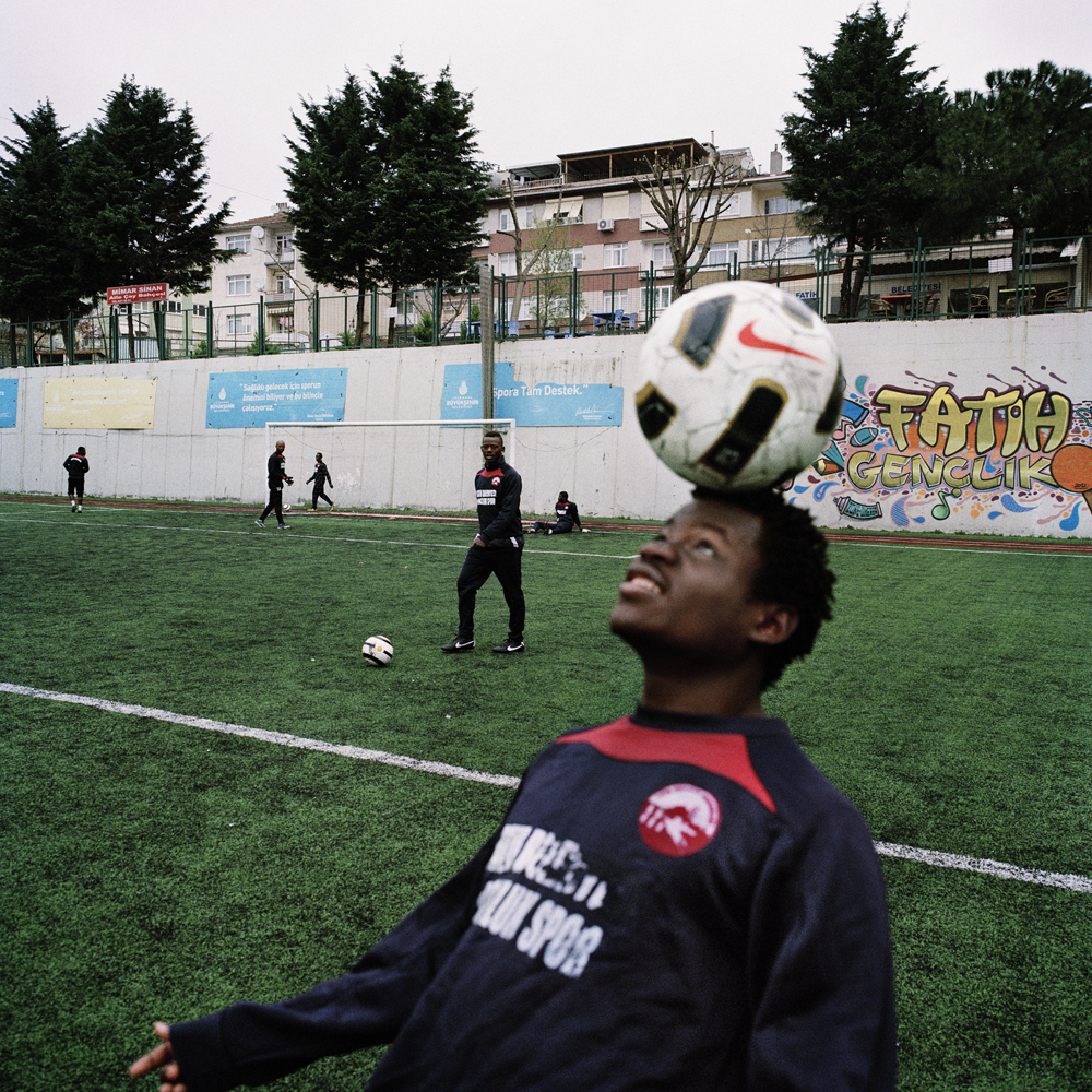 A soccer player practices for the African Friendship Sports team, works with the ball during morning soccer practice at the Fatih Belediyesi Mimar Sinan Stadium in April 2013 in Istanbul.