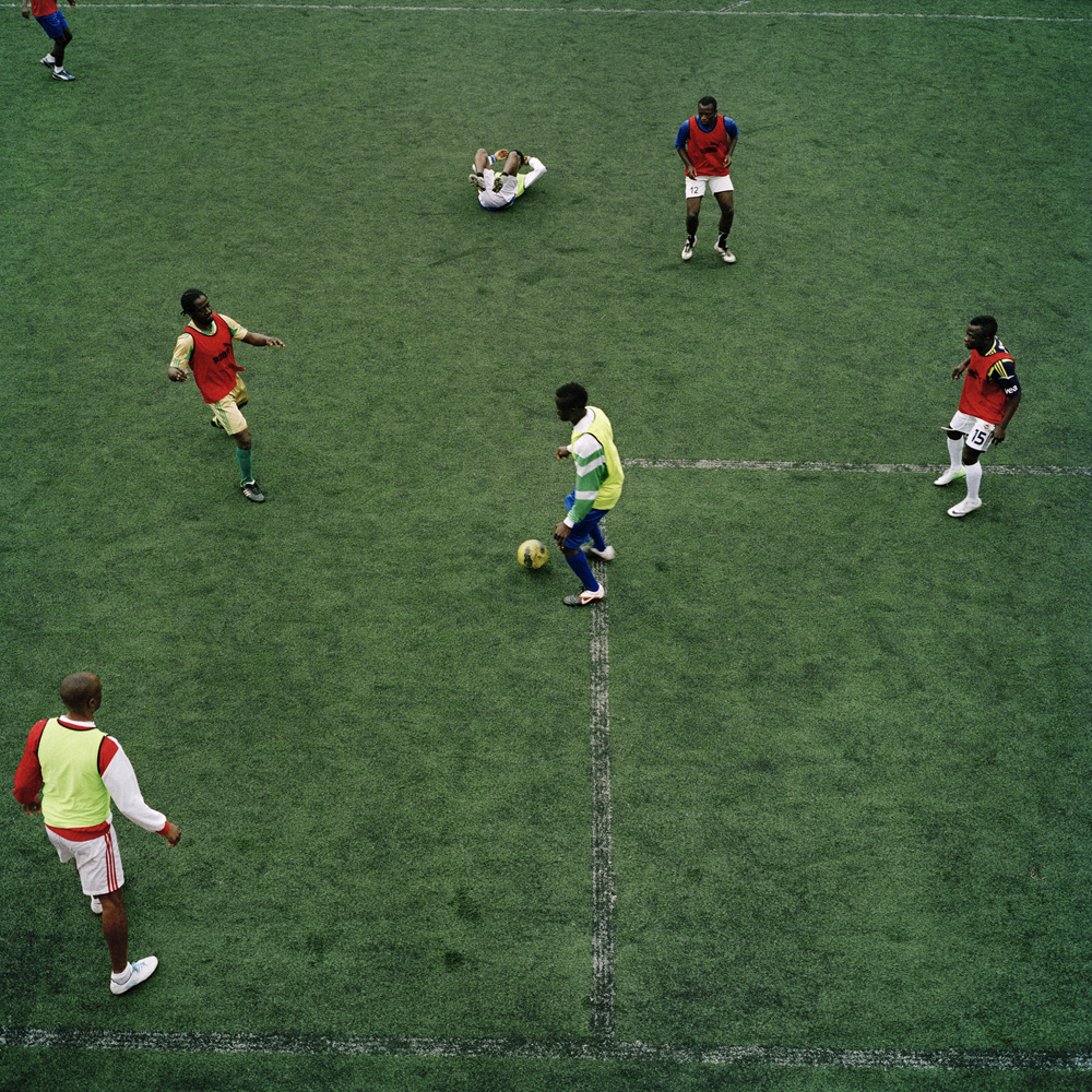 Nigerian soccer players practice a football drill on the run-down Feriköy pitch in Kurtulus in April 2013 in Istanbul.
