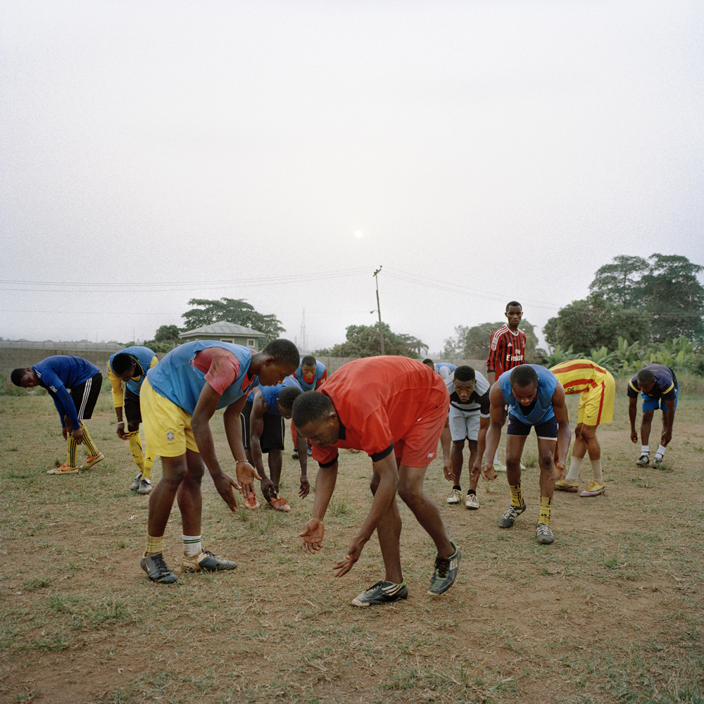 Adegeye, a former professional Nigerian soccer player, leads members of the Freedom Foundation Apostolic Revival International Ministries (FARIM) soccer team through exercises at the Government Technical College in February 2014 in Ikorodu, Nigeria.