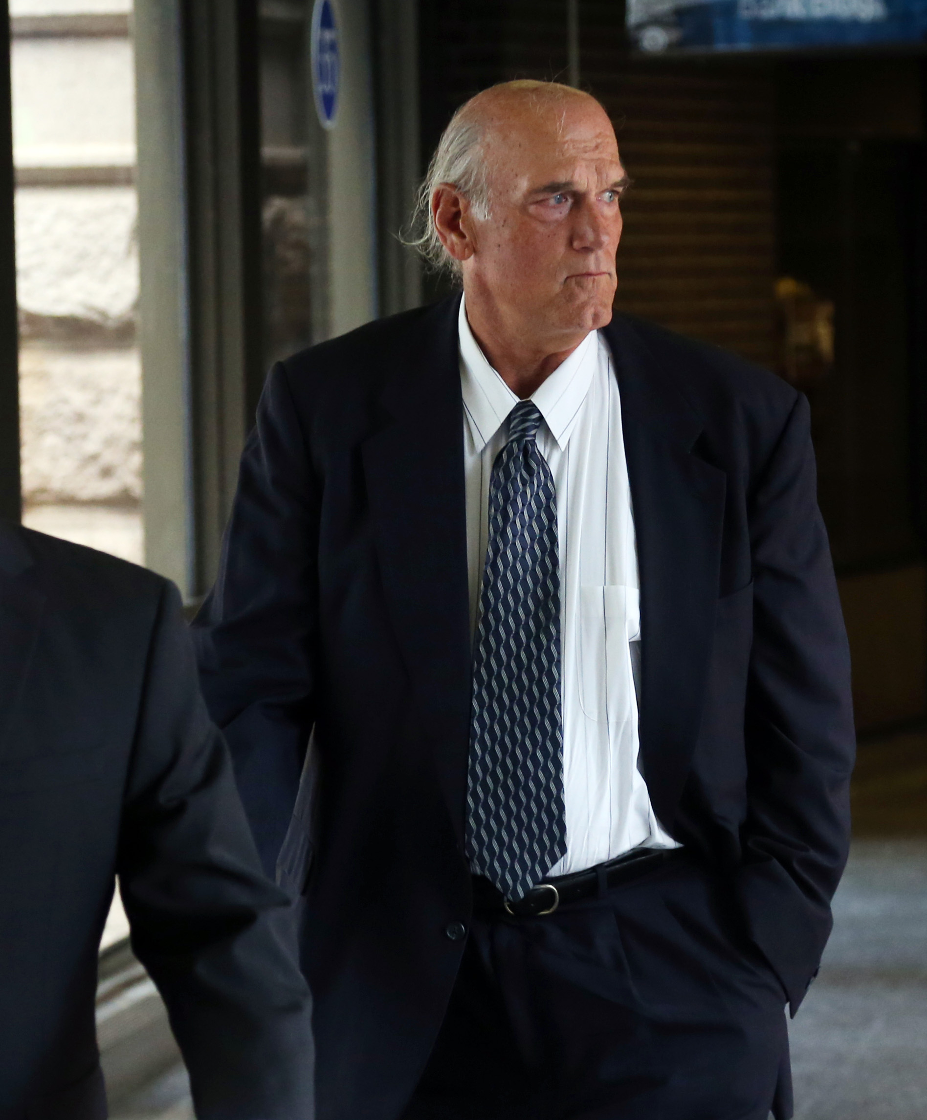 Former Minnesota Gov. Jesse Ventura makes his way back into Warren E. Burger Federal Building during the first day of jury selection in a defamation lawsuit, on July 8, 2014 in St. Paul, Minn.
