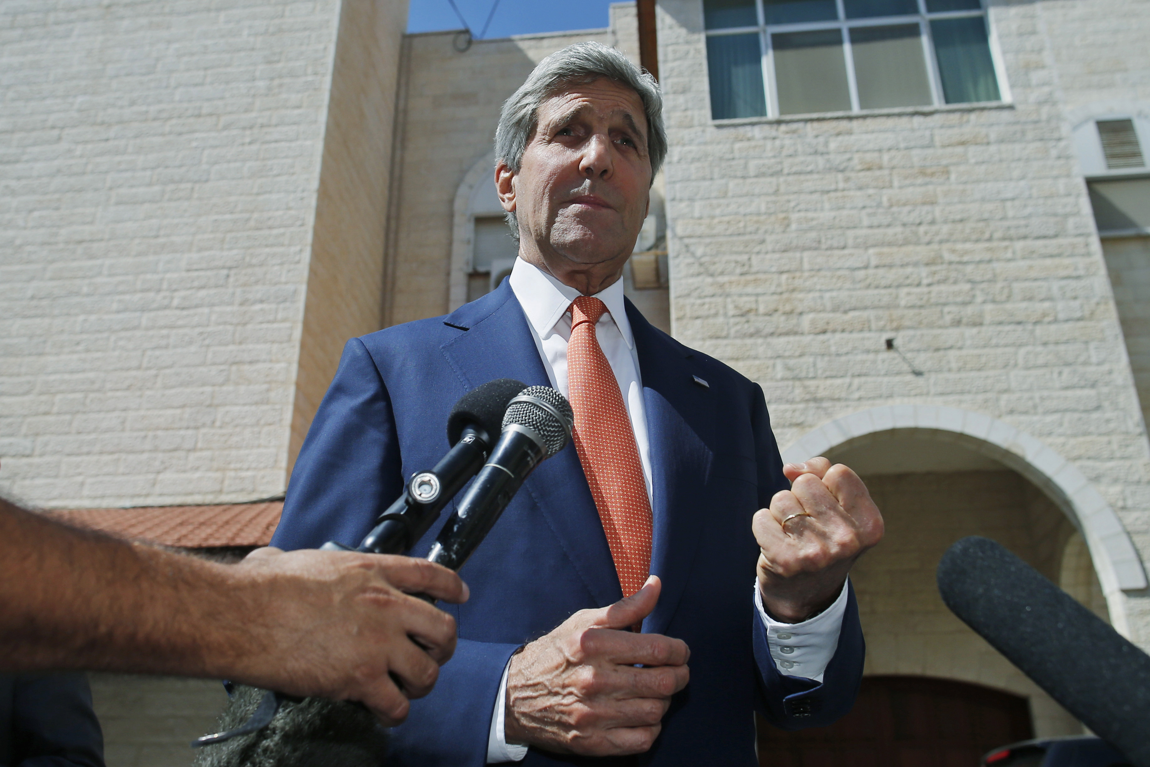 U.S. Secretary of State John Kerry speaks to reporters after meeting with Palestinian President Mahmoud Abbas in the West Bank city of Ramallah on July 23, 2014.