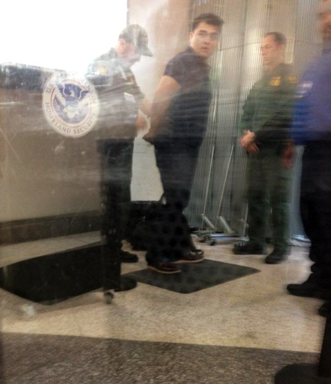 Jose Antonio Vargas in handcuffs at the airport in McAllen, Texas, on July 15, 2014