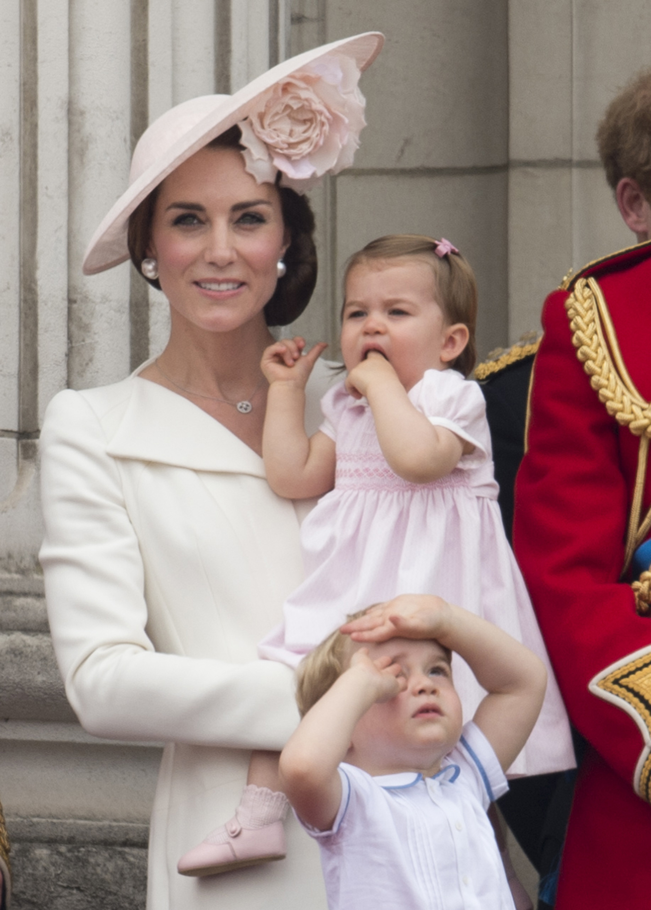 Catherine, Duchess of Cambridge with Princess Charlotte of Cambridge and Prince George of Cambridge during the Trooping the Colour, this year marking the Queen's 90th birthday at The Mall in London on June 11, 2016.