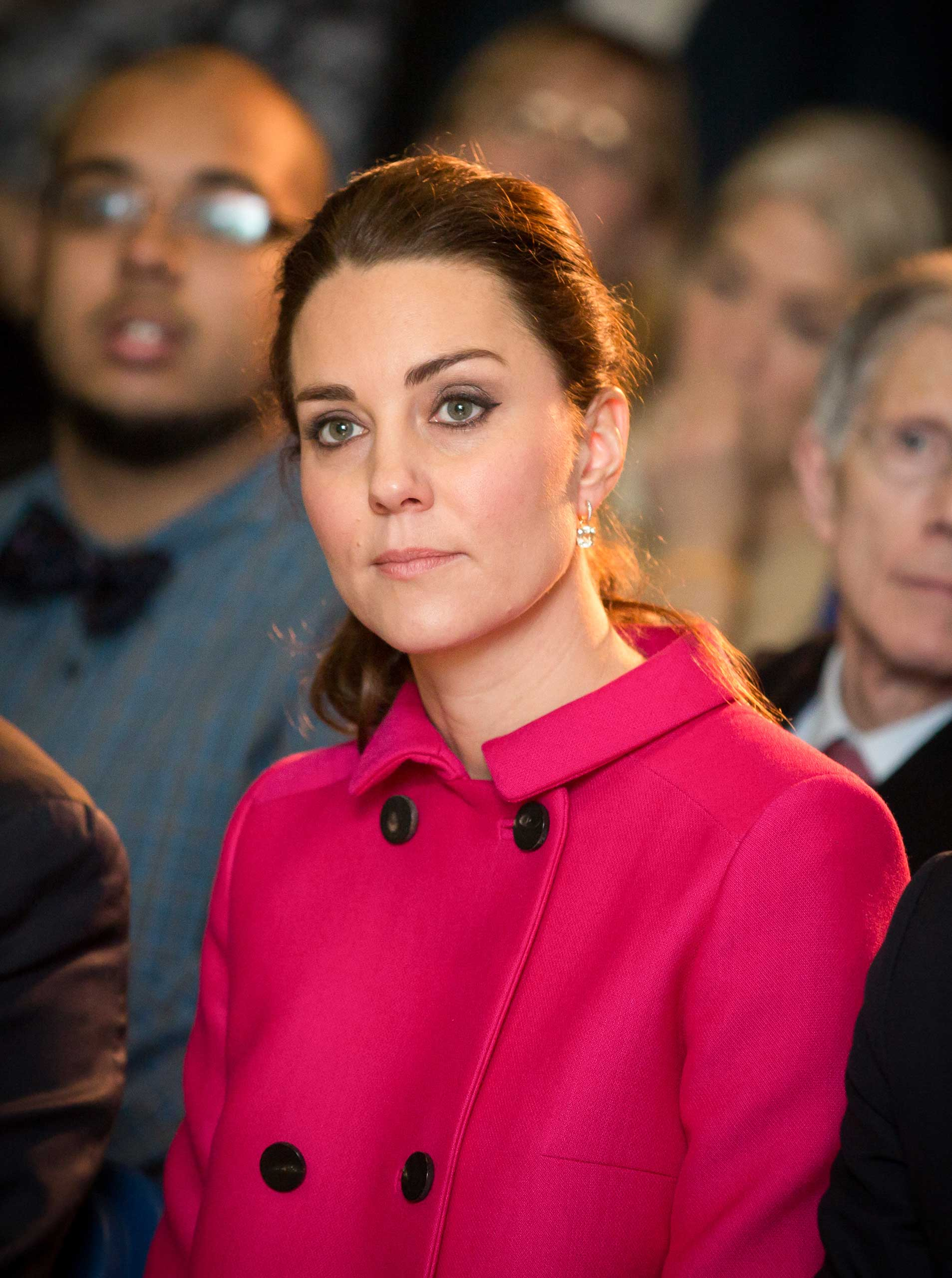Catherine, Duchess of Cambridge watches an art performance as they visit The Door/City Kids Foundation on Dec. 9, 2014 in New York City.
