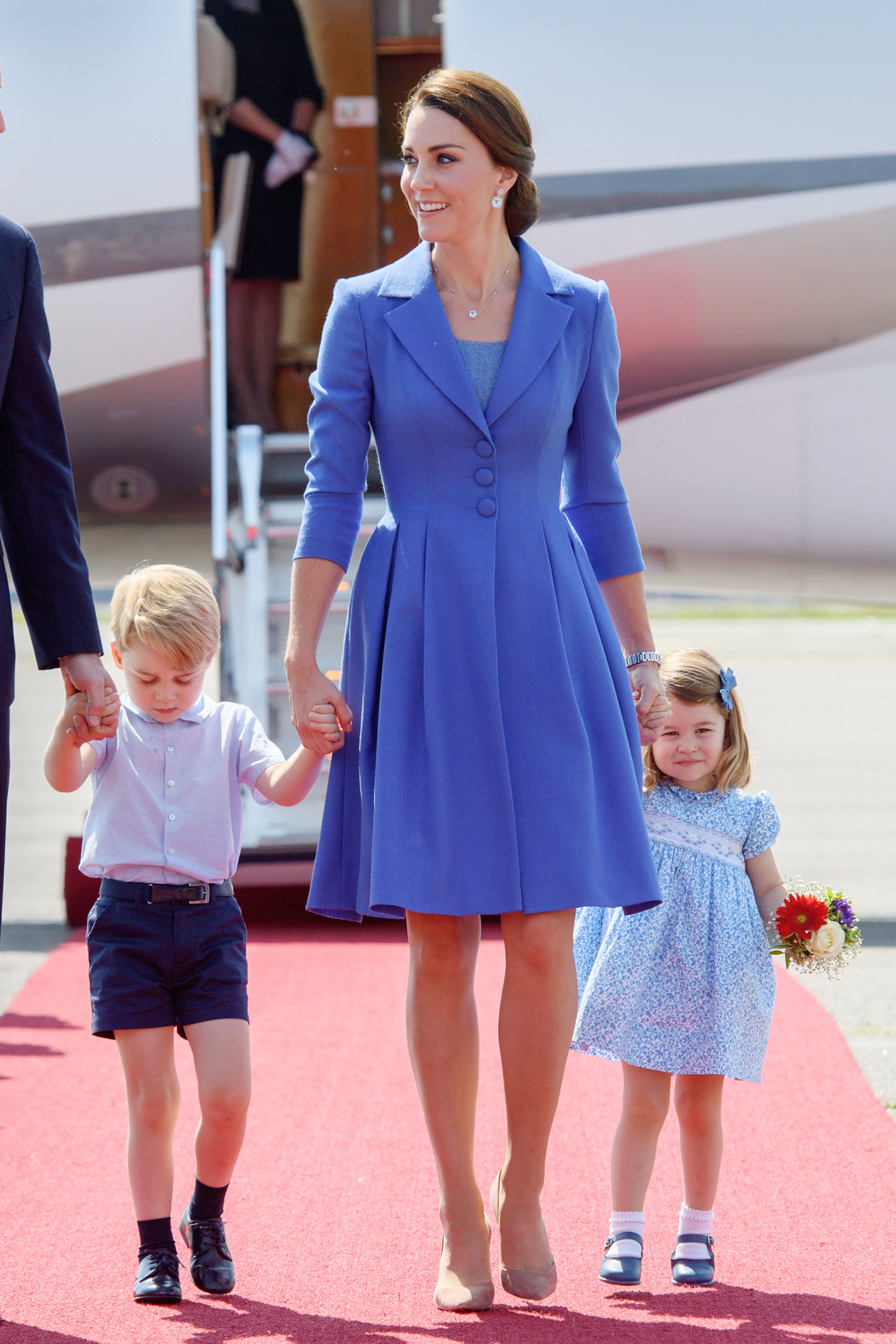 Catherine, Duchess of Cambridge, Prince George of Cambridge and Princess Charlotte of Cambridge arrive at Berlin military airport during an official visit to Poland and Germany on July 19, 2017.