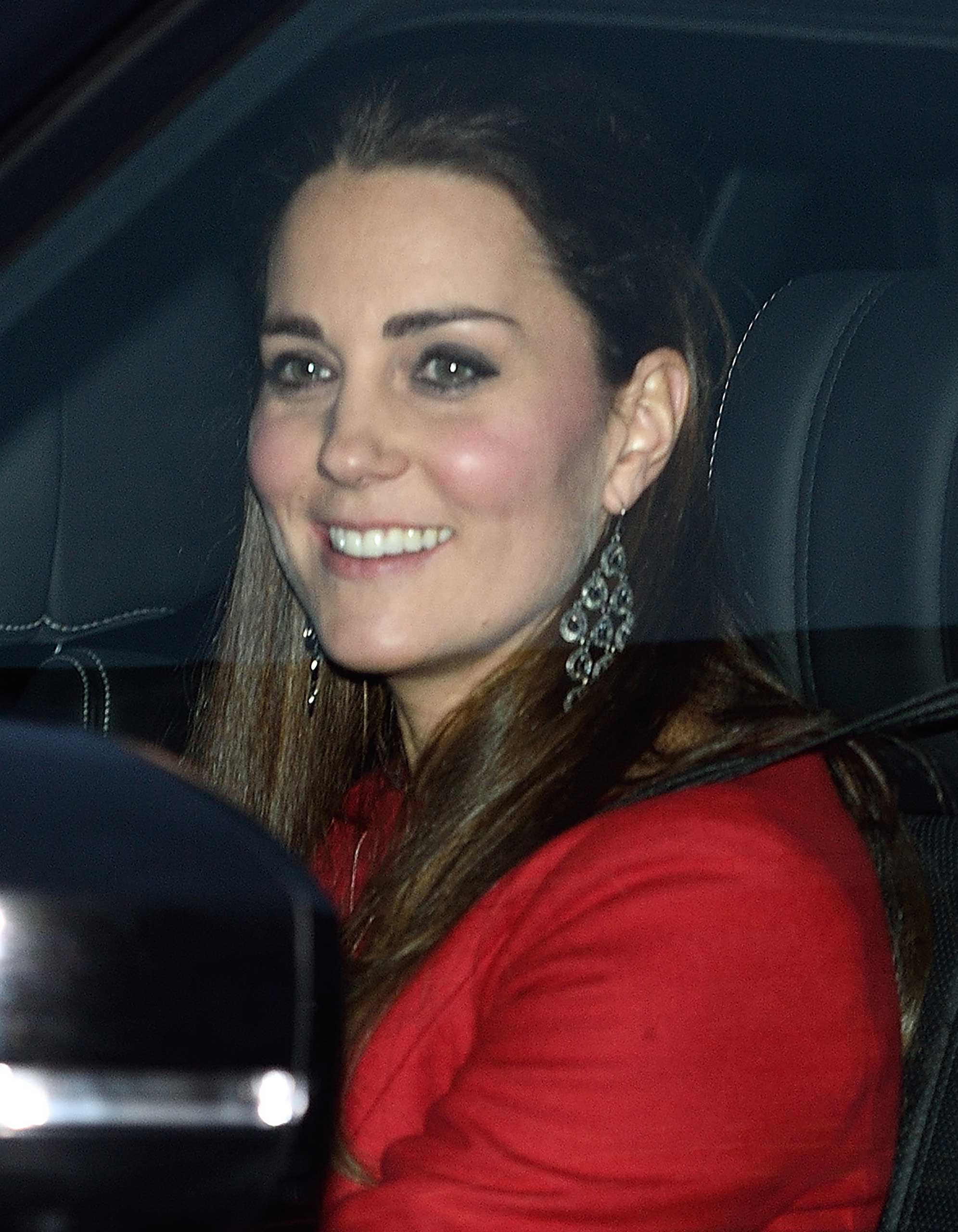 Catherine, Duchess of Cambridge departs from the Buckingham Palace Pre-Christmas Lunch at Buckingham Palace in London on Dec. 17, 2014.