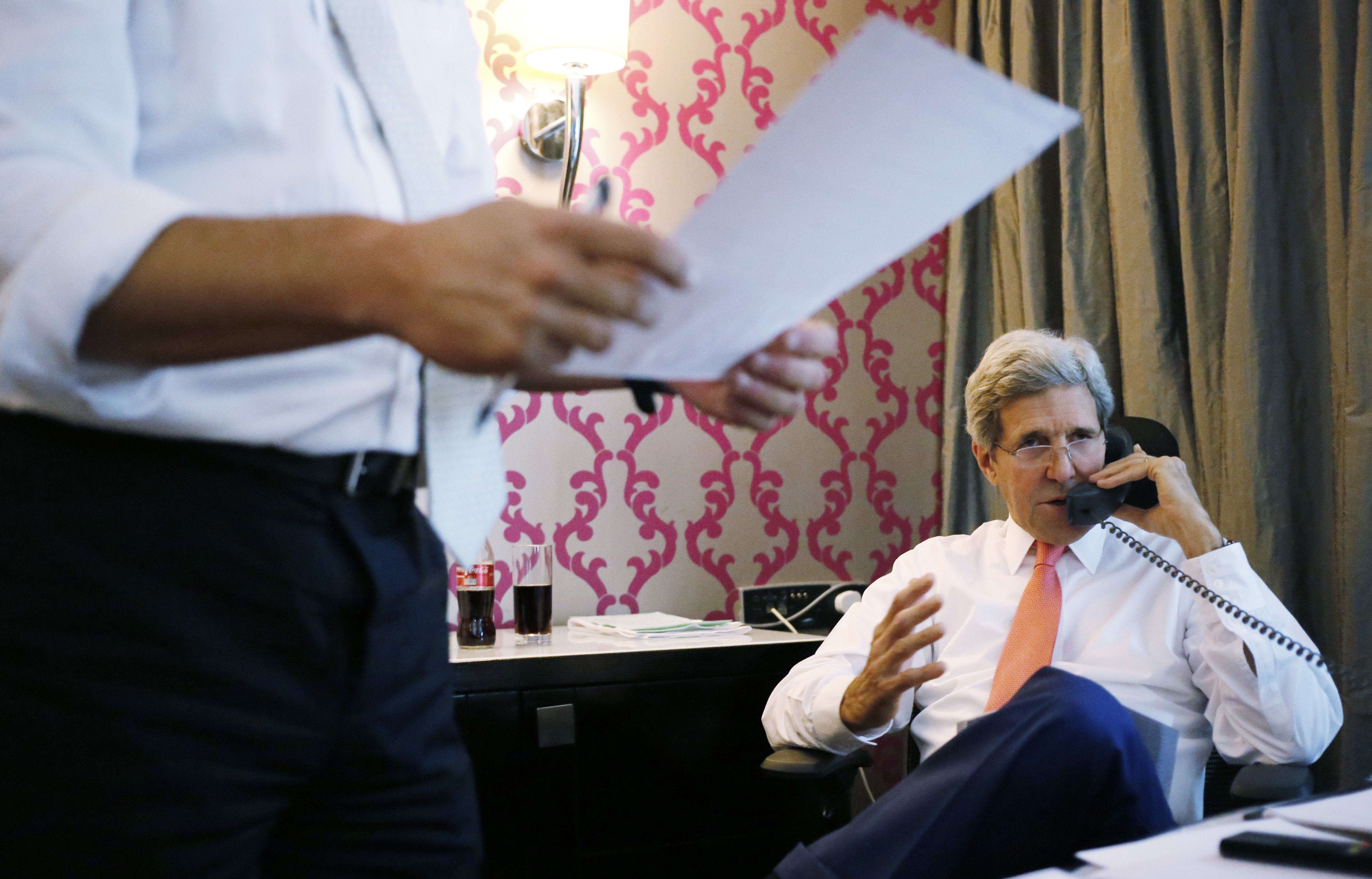 U.S. Secretary of State John Kerry talks to Israeli Prime Minister Benjamin Netanyahu about terms of a cease-fire in fighting in Gaza between Israel and Hamas on July 25, 2014.
