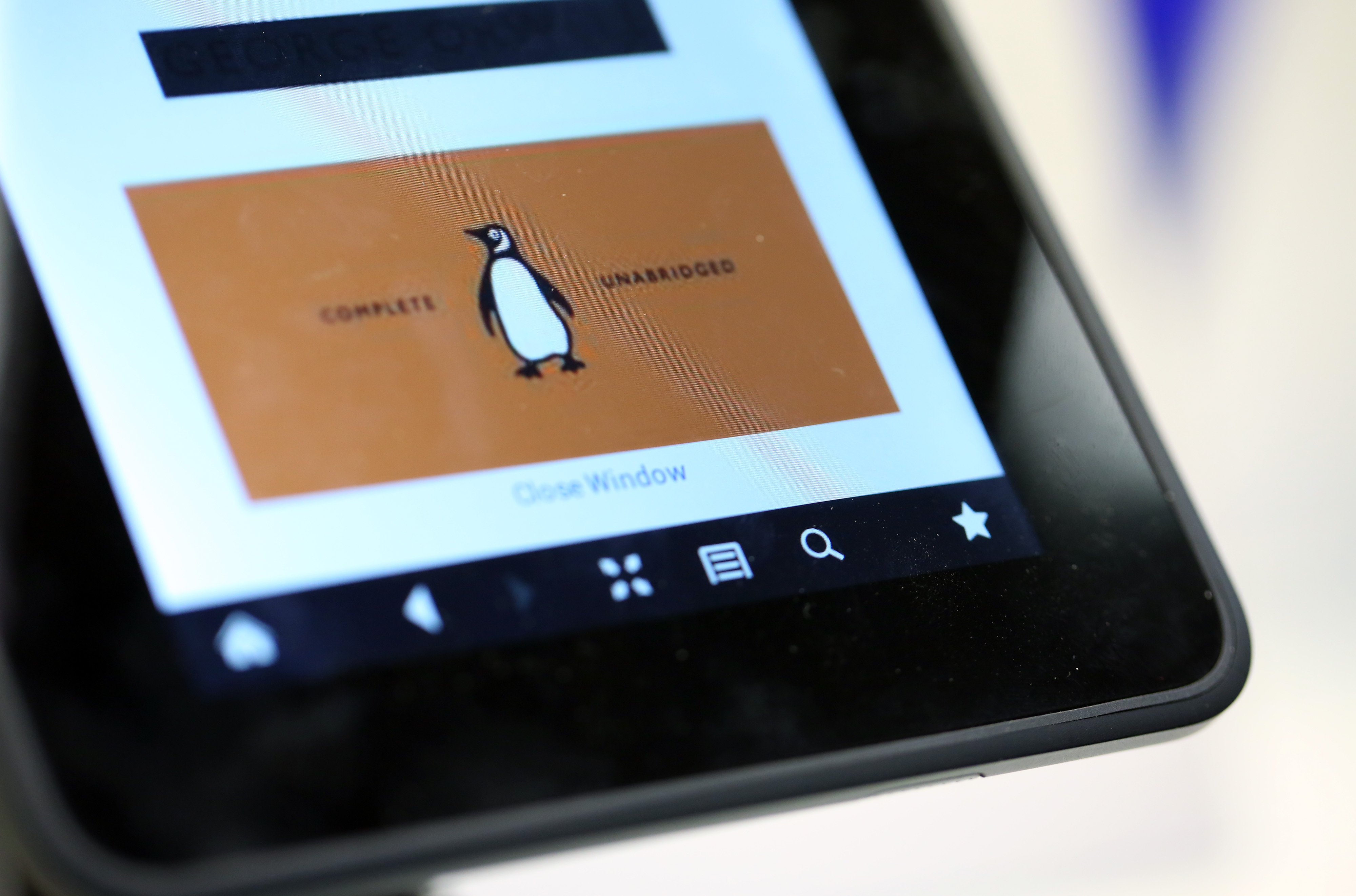 The logo of the Penguin publishing house, part of Pearson Plc, is seen on a Kindle Fire HD e-reader at a bookstore in London, U.K., on Friday, April 5, 2013.