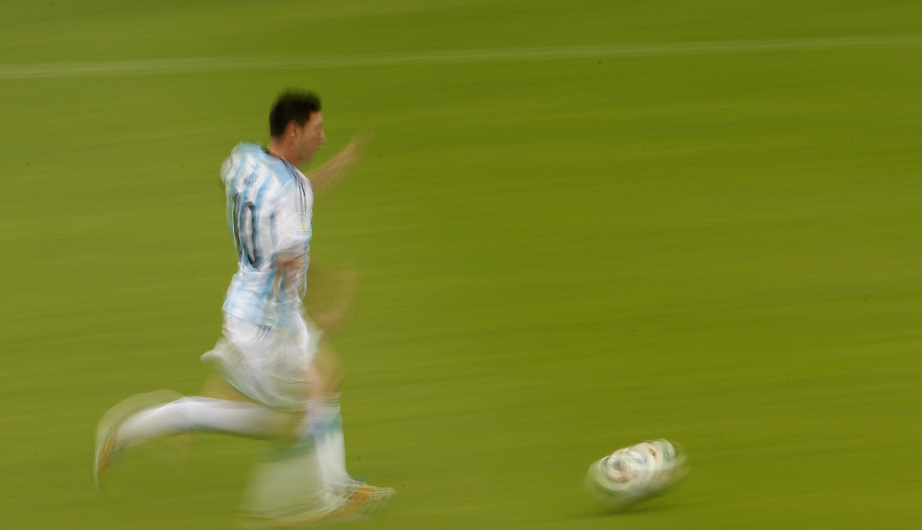 Argentina's Lionel Messi runs with the ball during the Group F football match between Nigeria and Argentina at the Beira-Rio Stadium in Porto Alegre on June 25, 2014,