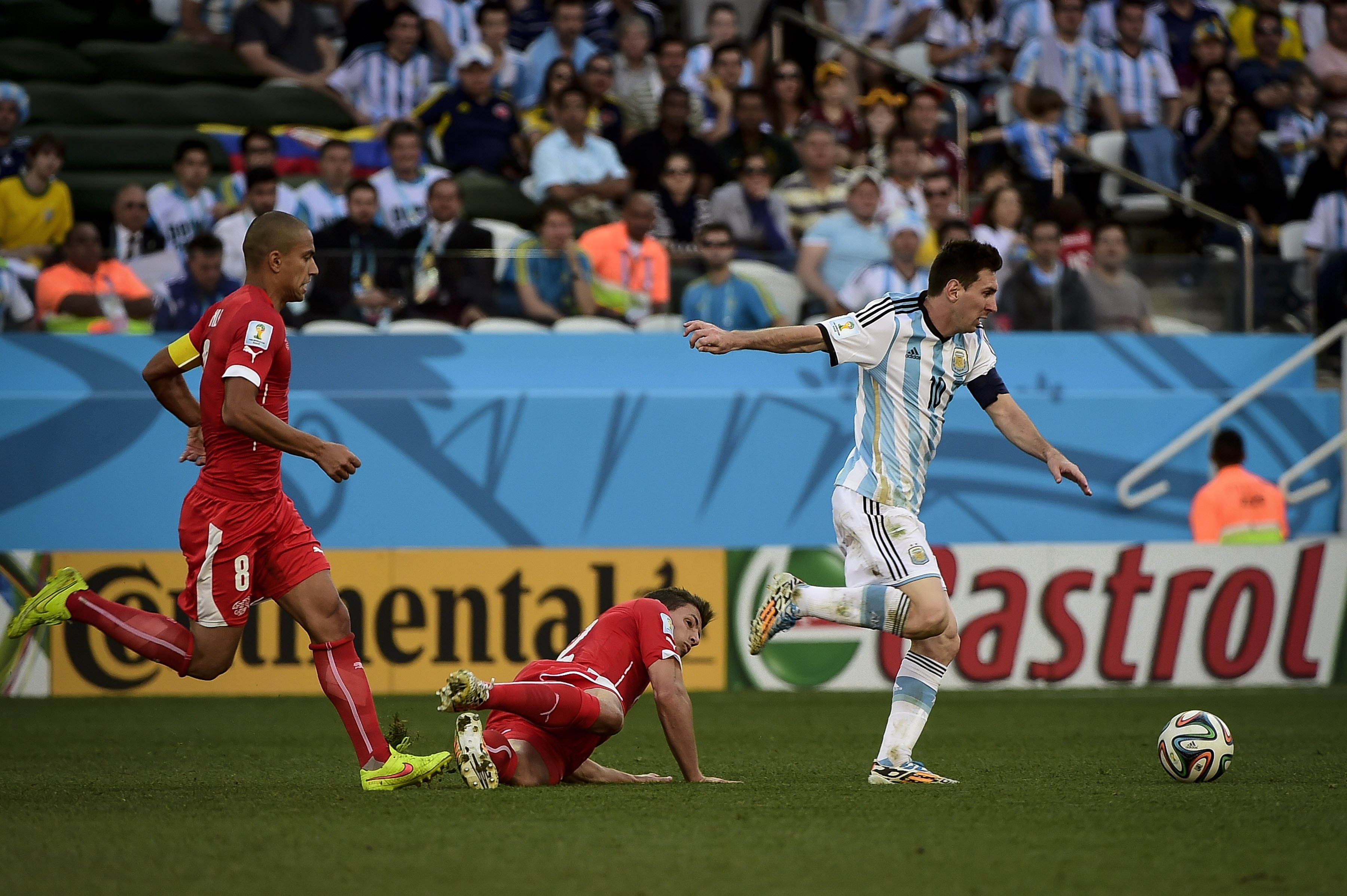 Lionel Messi (10) carries the ball through the midfiel during the Round of 16 of the 2014 World Cup, between Argentina and Switzerland, on  July 1st, in Sao Paulo, Brazil.