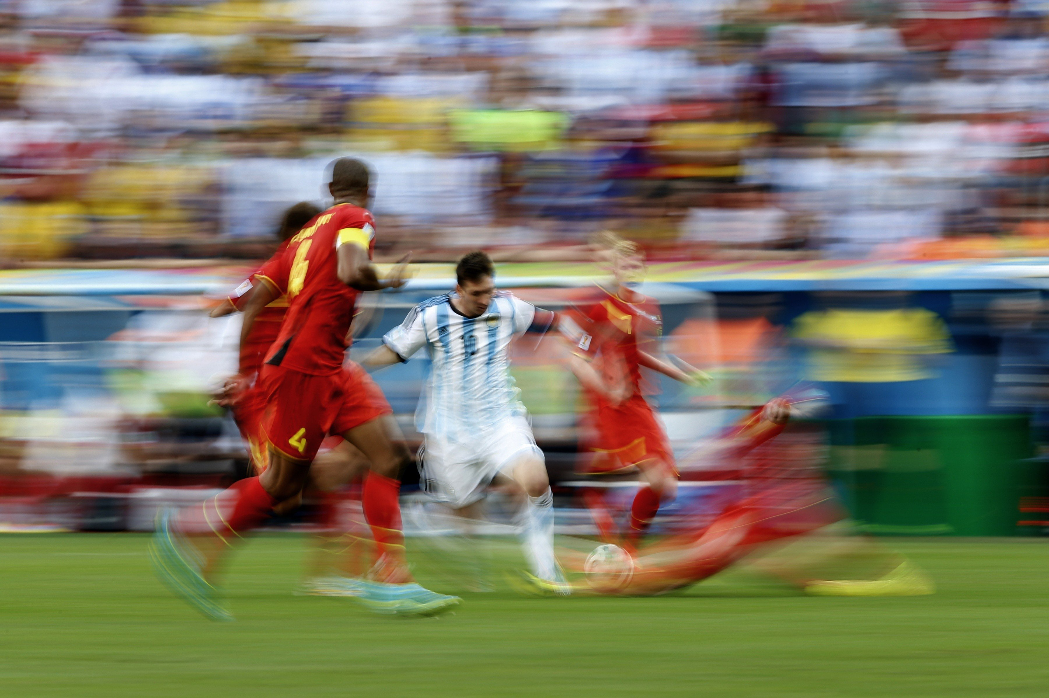 Argentina's Lionel Messi  vies for the ball during a quarter-final football match between Argentina and Belgium at the Mane Garrincha National Stadium in Brasilia during the 2014 FIFA World Cup on July 5, 2014.