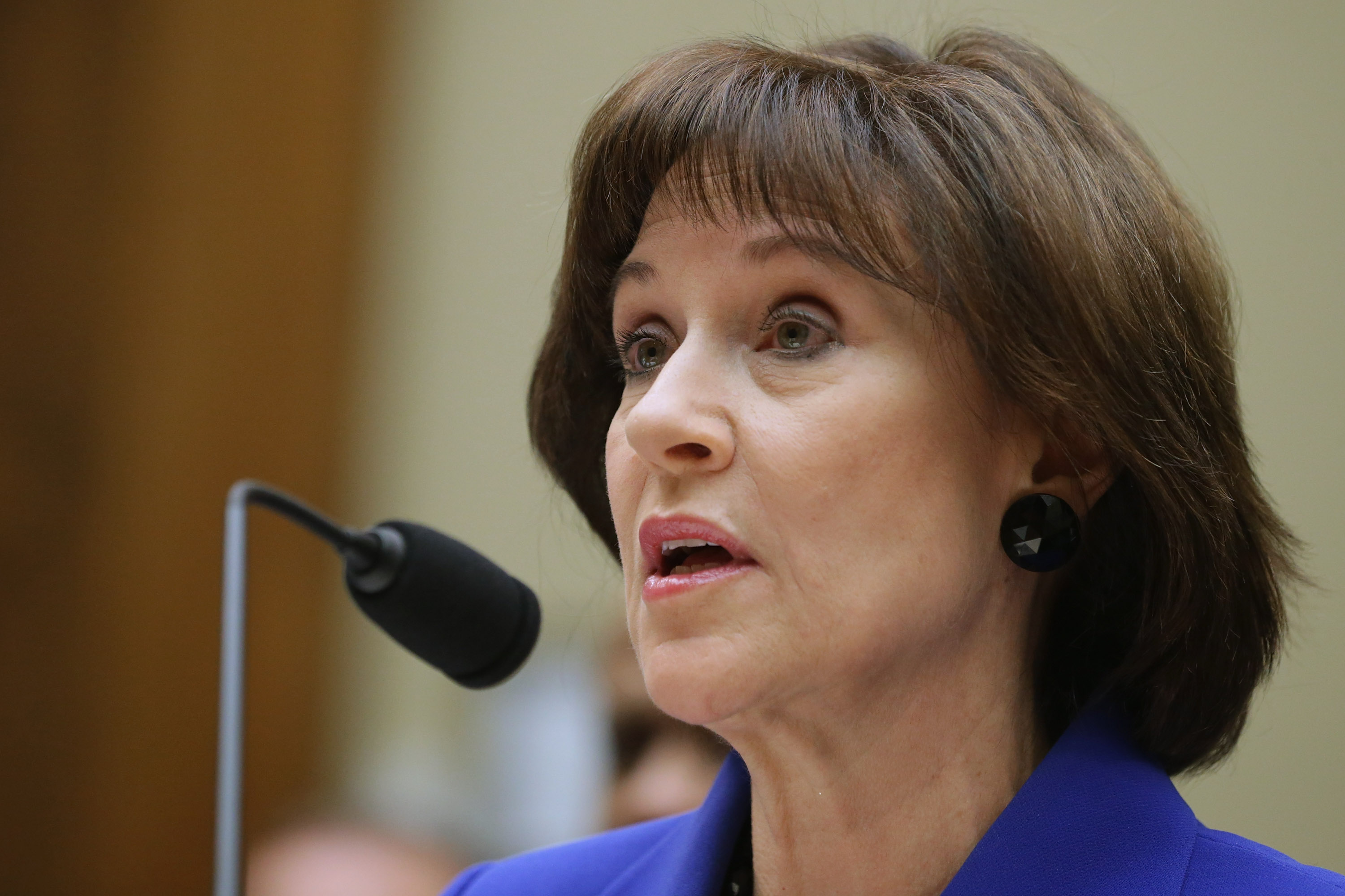 Former Internal Revenue Service official Lois Lerner exercises her Fifth Amendment right not to speak about the IRS targeting investigation before the House Oversight and Government Reform Committee during a hearing in the Rayburn House Office Building on March 5, 2014 in Washington.