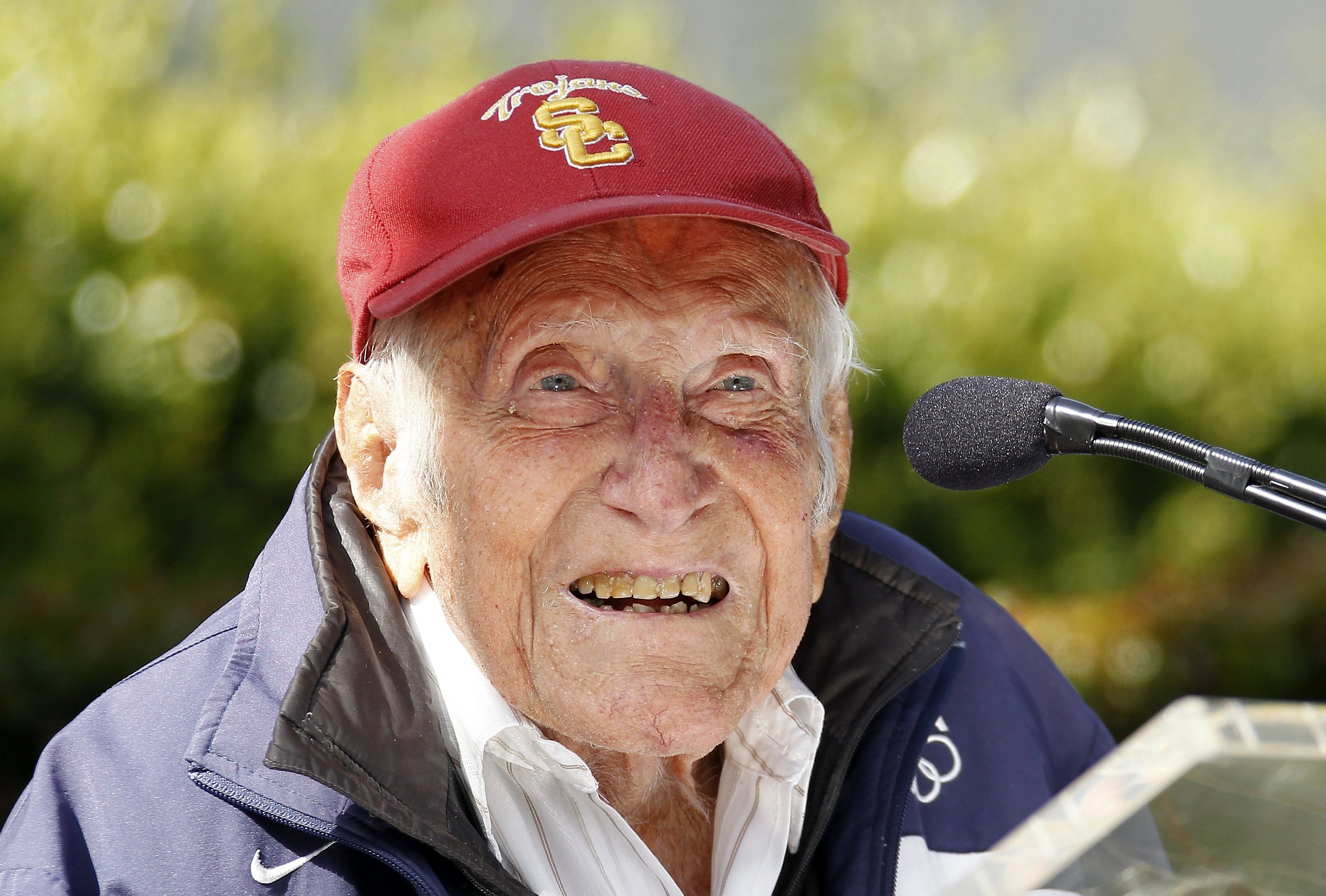 Louis Zamperini gestures during a news conference, in Pasadena, Calif. Zamperini, a U.S. Olympic distance runner and World War II veteran who survived 47 days on a raft in the Pacific after his bomber crashed, then endured two years in Japanese prison camps, died Wednesday, July 2, 2014.
