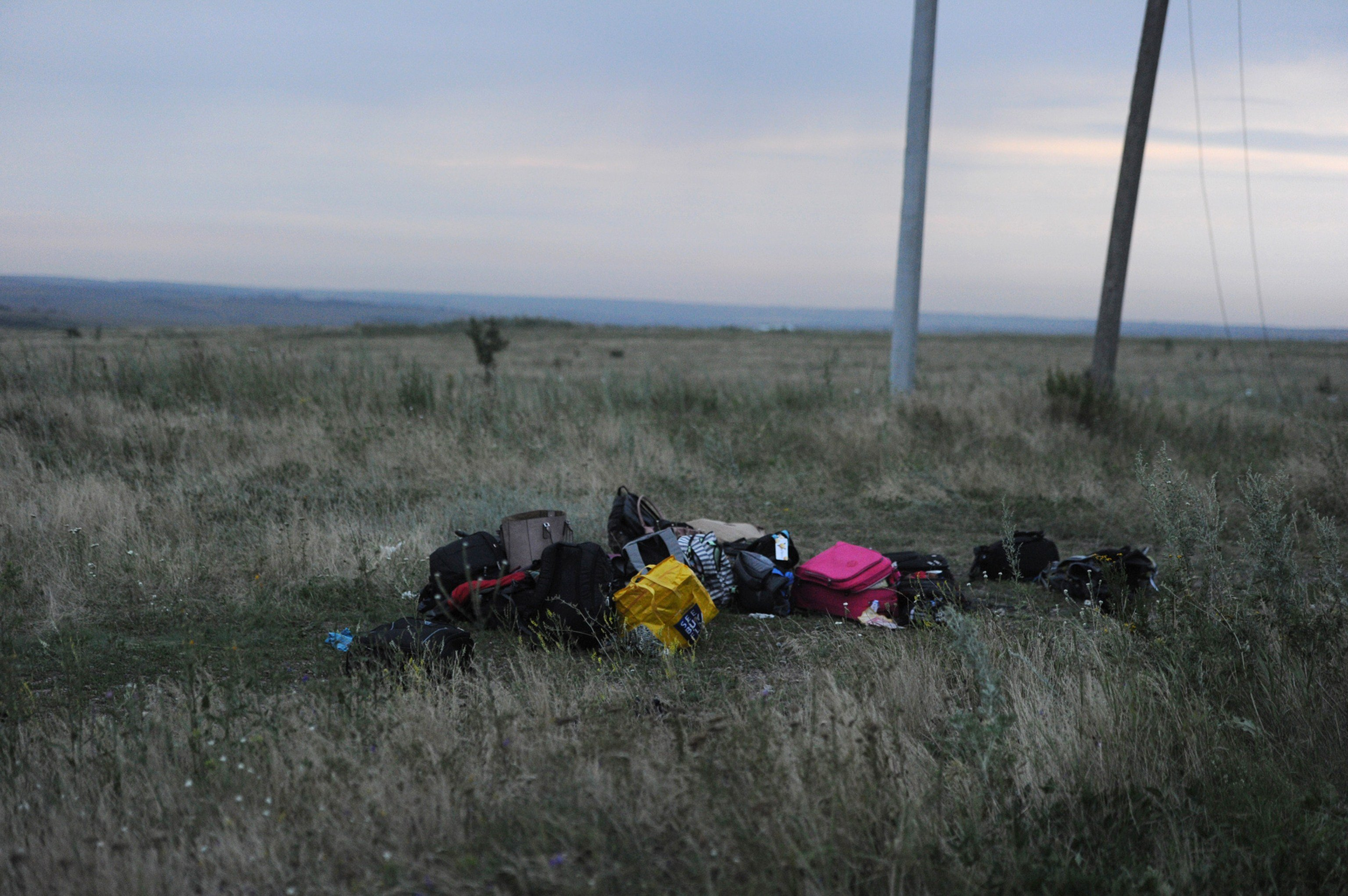 Luggage seen at the crash site the Malaysian airliner carrying 298 people from Amsterdam to Kuala Lumpur, near the town of Shaktarsk, in rebel-held east Ukraine, July 17, 2014
