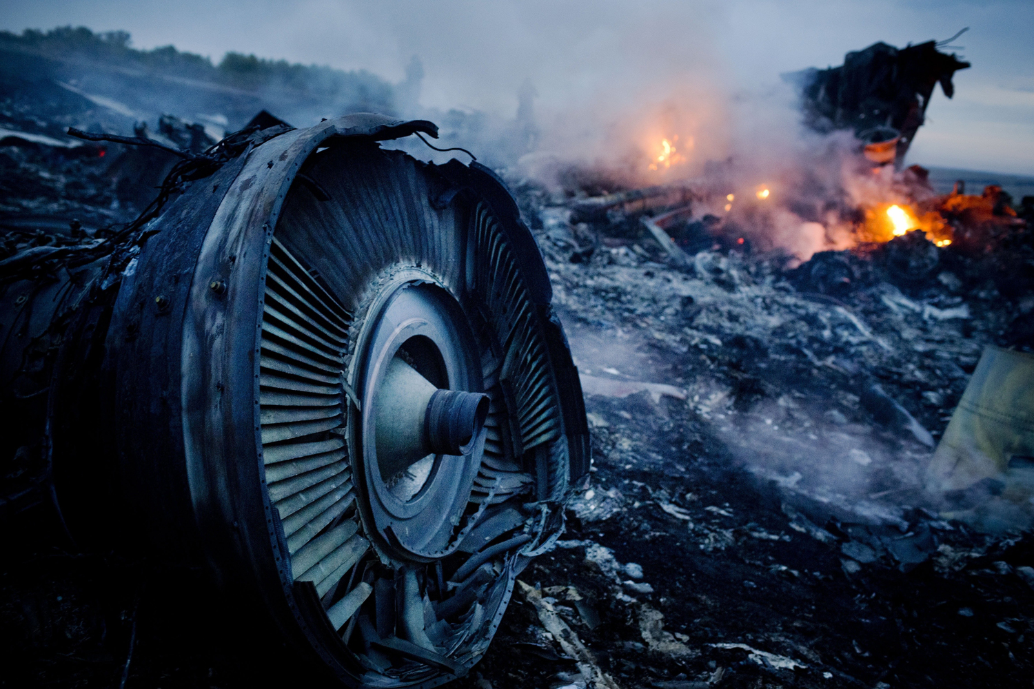 Debris from Malaysia Airlines Flight 17 is shown smouldering in a field  July 17, 2014 in Grabovo, Ukraine.