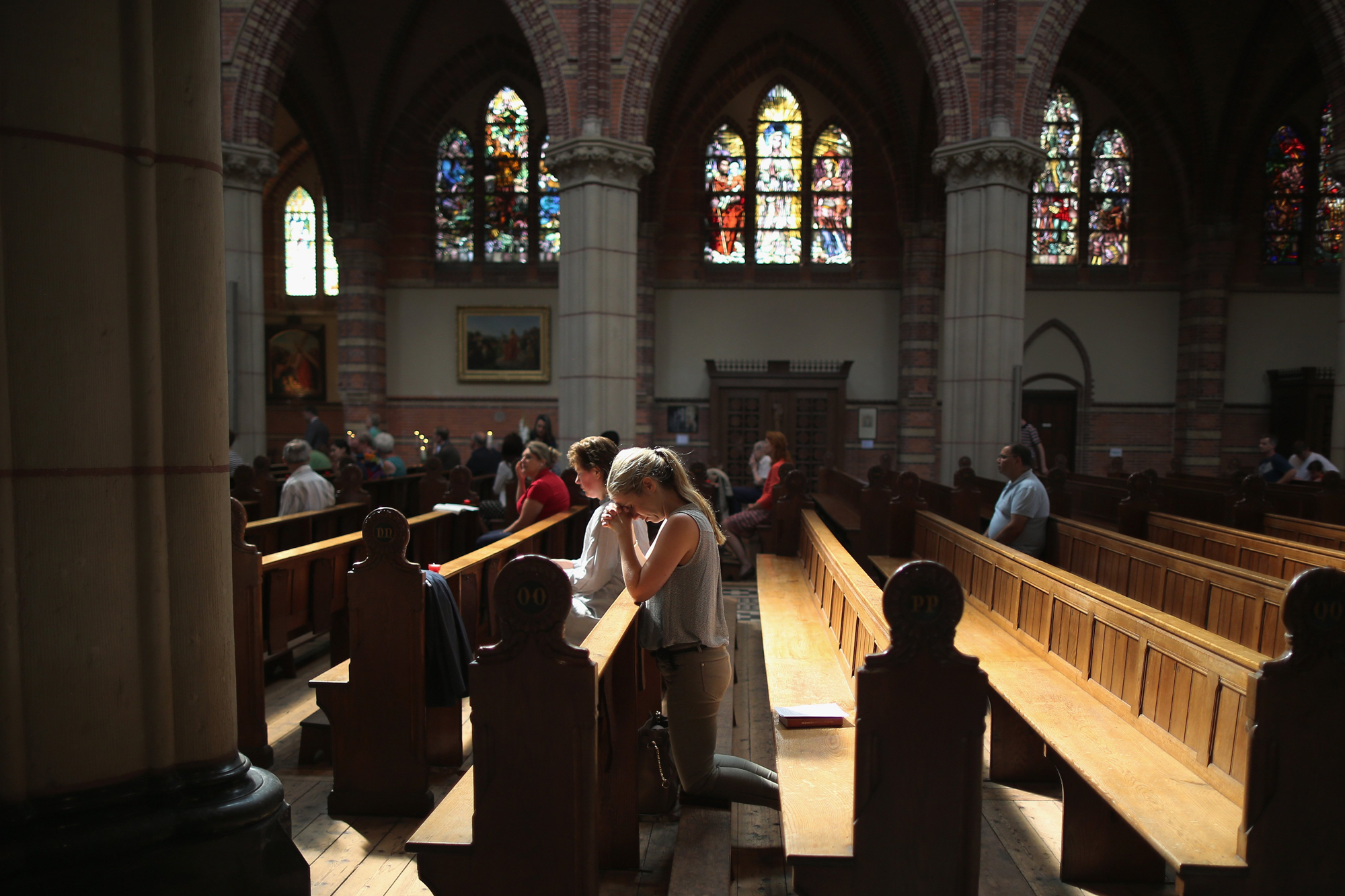 Local people pray during a special mass in Saint Vitus Church in memory of the victims of Malaysia Airlines flight MH17 on July 20, 2014 in Hilversum, Netherlands.