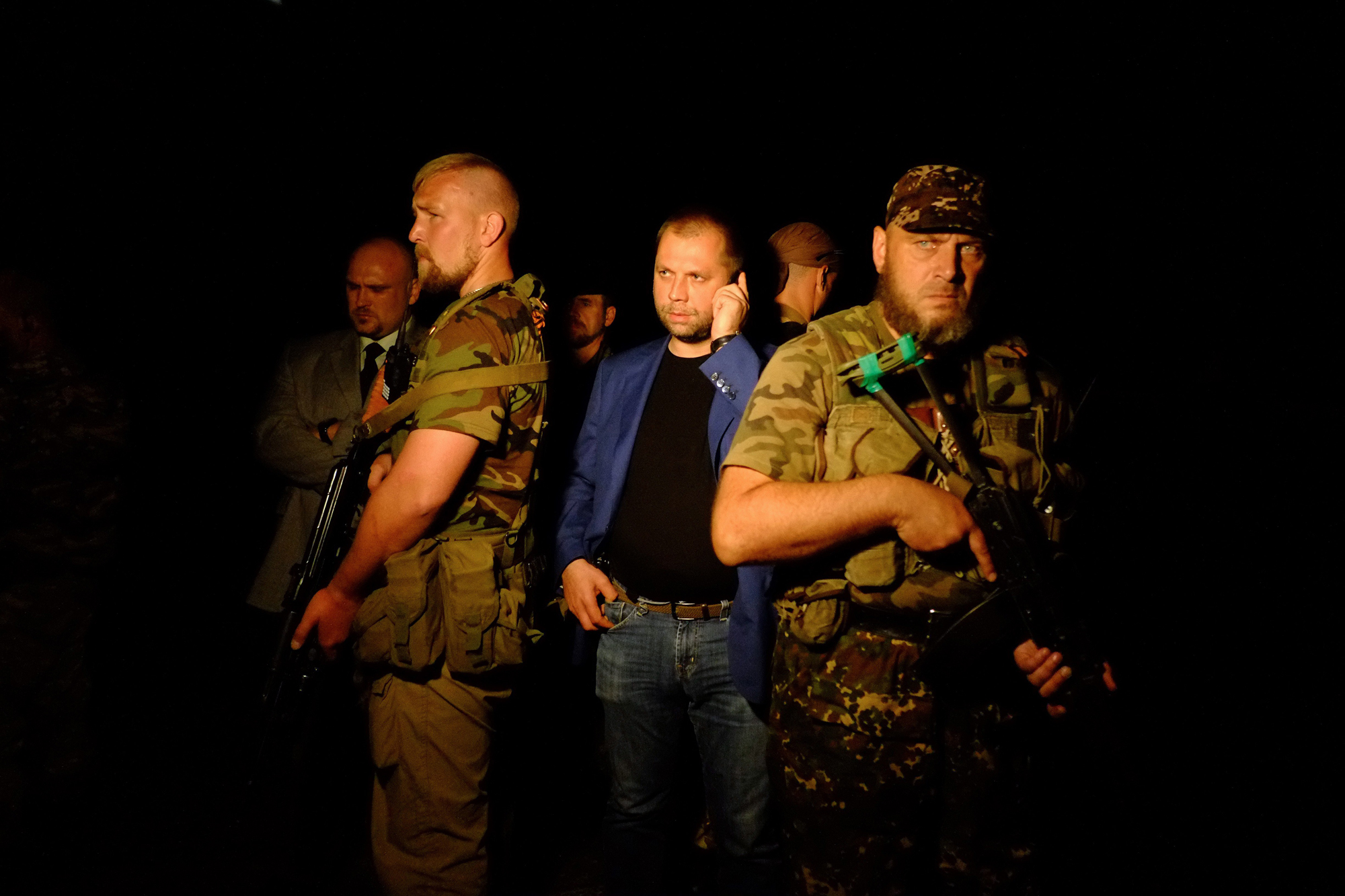 "Self-proclaimed Prime Minister of the pro-Russian separatist ""Donetsk People's Republic"" Alexander Borodai stands as he arrives on the site of the crash of a malaysian airliner carrying 298 people from Amsterdam to Kuala Lumpur, near the town of Shaktarsk, in rebel-held east Ukraine, on July 17, 2014."
