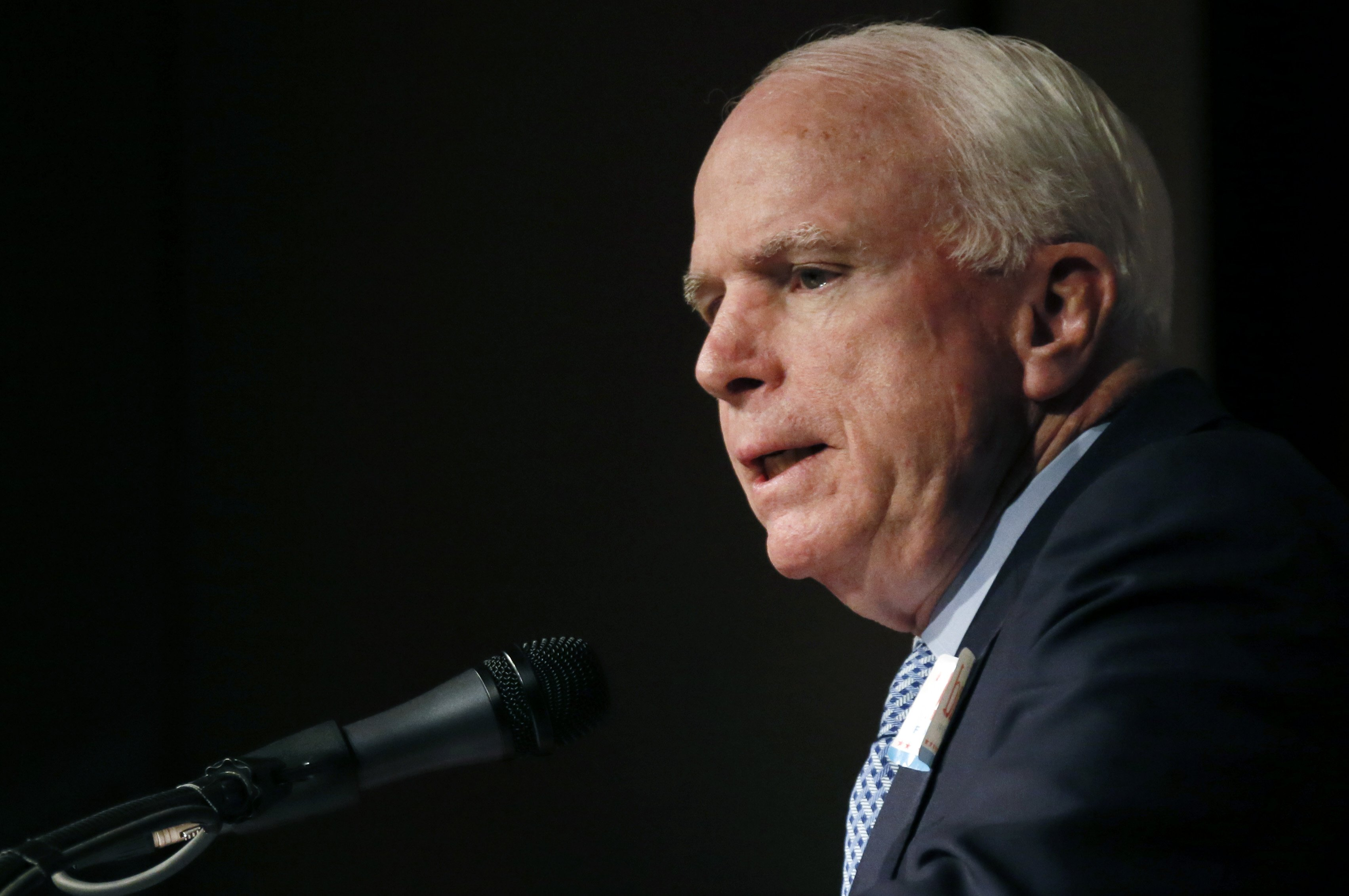 U.S. Sen. John McCain, R-Ariz., criticizes the Obama administration during a Jackson, Miss., runoff rally in support of Republican U.S. Sen. Thad Cochran at the Mississippi War Memorial in Jackson, Miss., June 23, 2014.