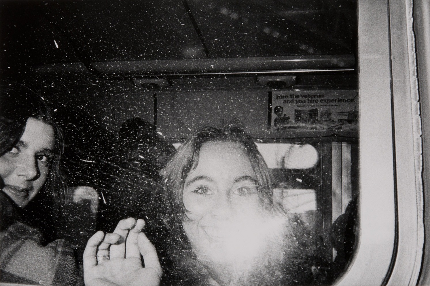 Untitled (girls' faces flashed in the bus window)