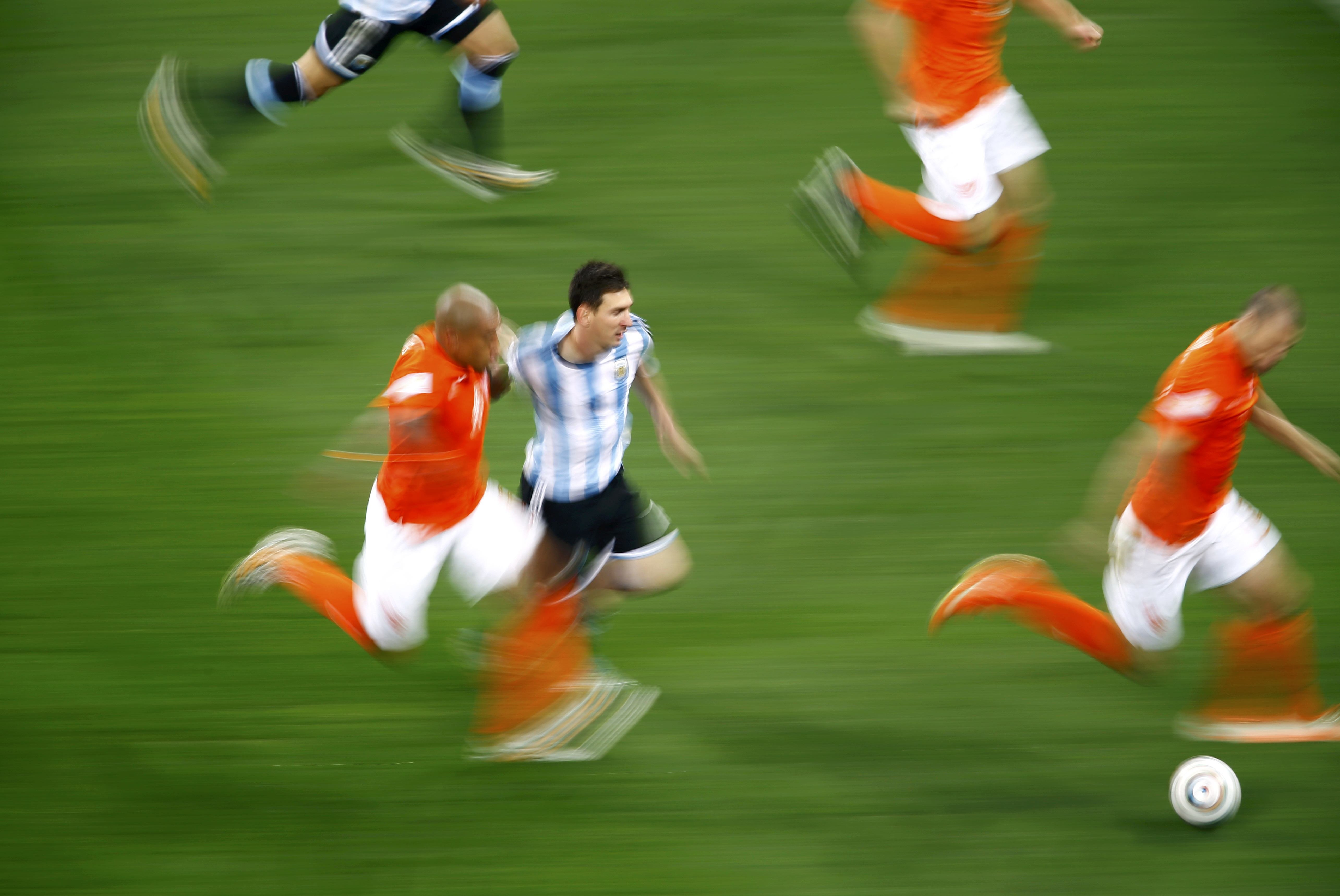 Argentina's Lionel Messi fights for the ball with Nigel de Jong of the Netherlands during their 2014 World Cup semi-finals at the Corinthians arena in Sao Paulo, Brazil on July 9, 2014.