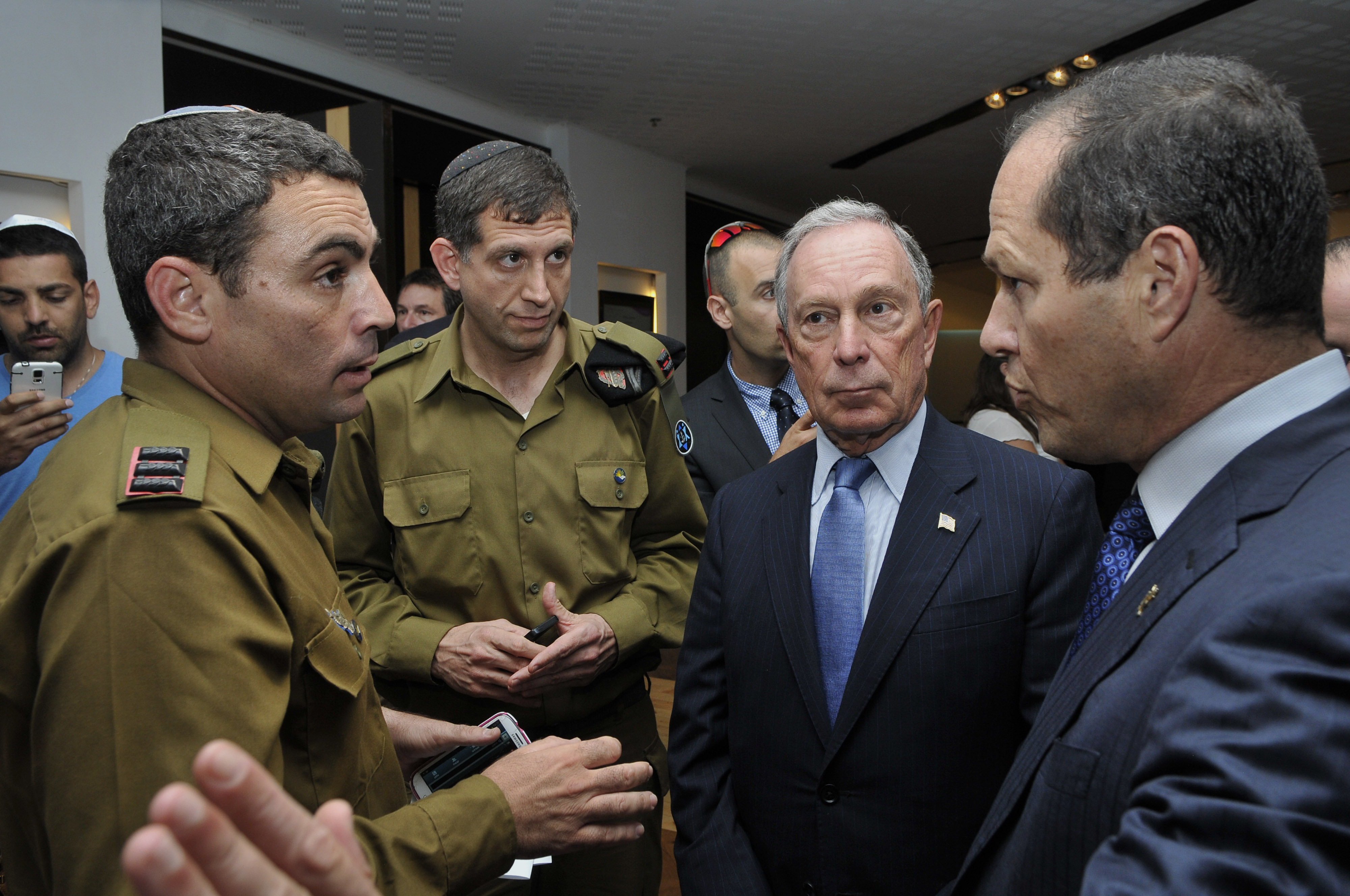 Mike Bloomberg, majority shareholder of Bloomberg LP and former New York mayor, second right, and Nir Barkat, mayor of Jerusalem, right, speak with member of the Israeli Defense Forces (IDF) in Jerusalem, Israel, on Wednesday, July 23, 2014.