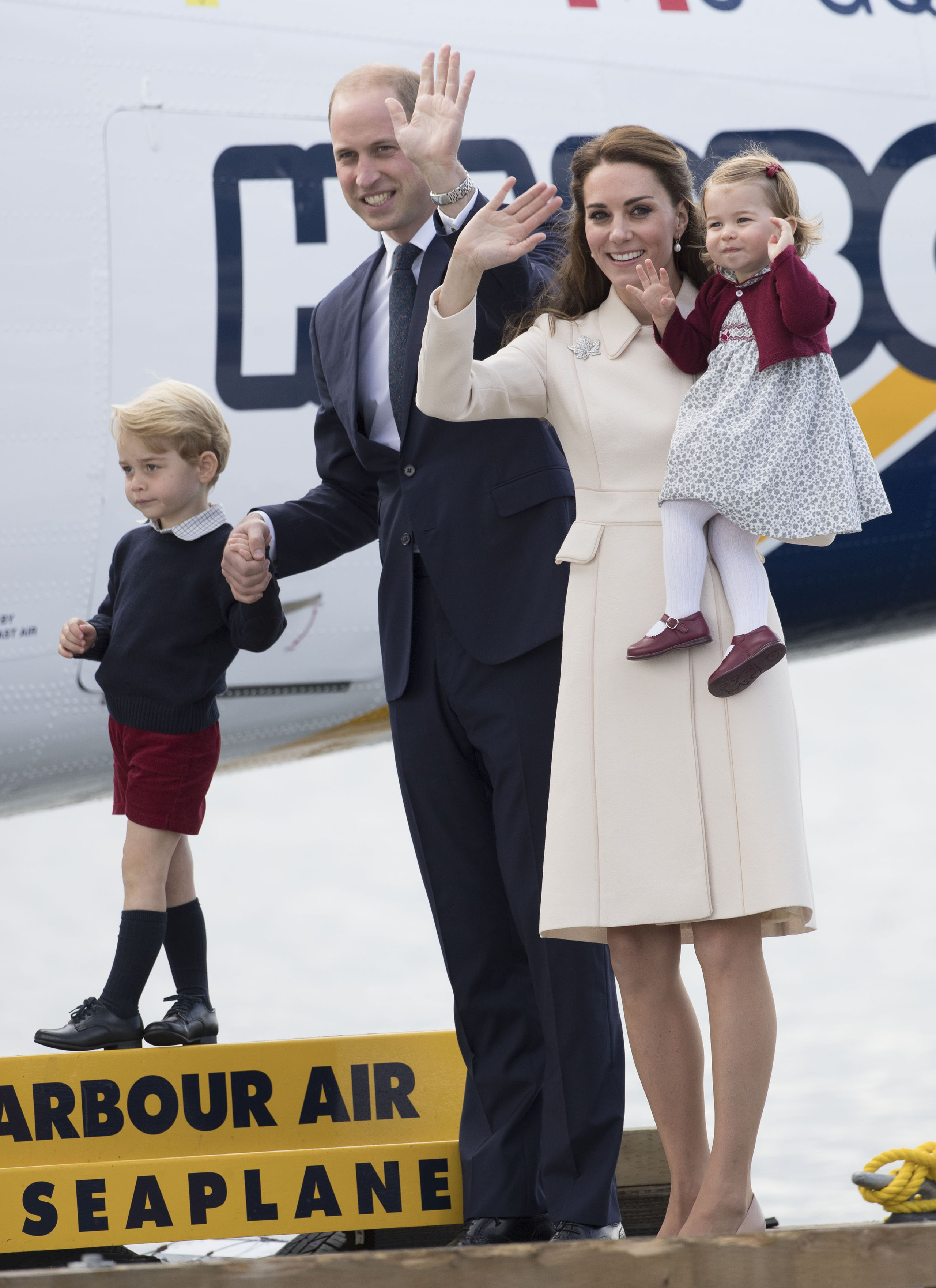 Prince William, Duke of Cambridge, Prince George of Cambridge, Catherine, Duchess of Cambridge and Princess Charlotte wave as they leave from Victoria Harbour to board a sea-plane on the final day of their Royal Tour of Canada on Oct. 1, 2016.