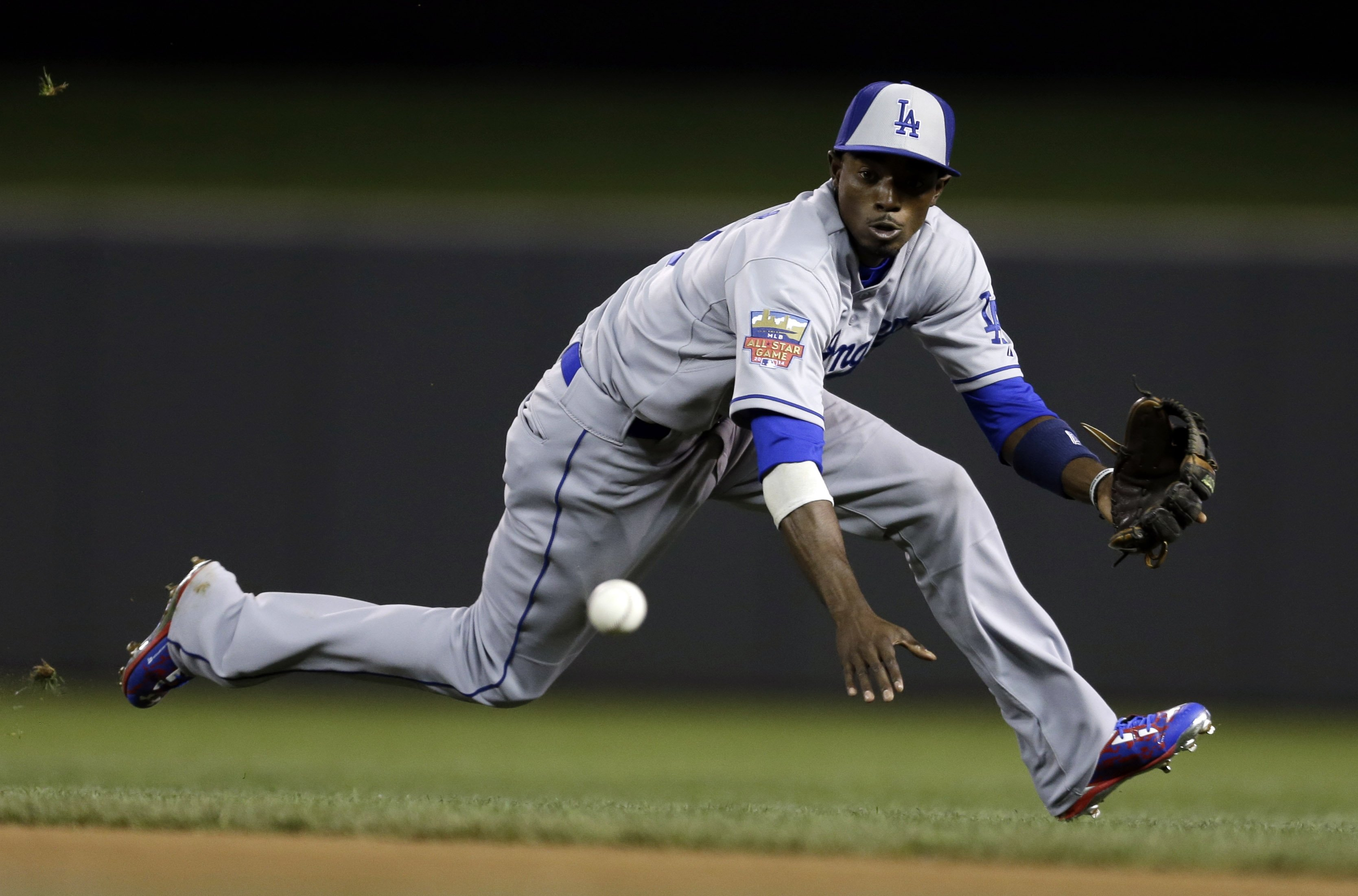 National League second baseman Dee Gordon, of the Los Angeles Dodgers, fields a ground ball hit by American League's Michael Brantley, of the Cleveland Indians, during the MLB All-Star baseball game on July 15, 2014, in Minneapolis.