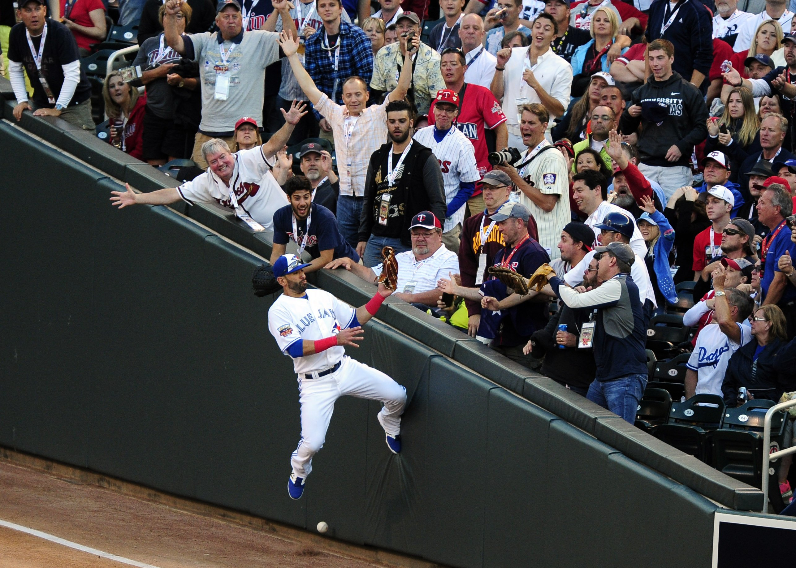 American League outfielder Jose Bautista (19) of the Toronto Blue Jays is unable to catch a fly ball in foul territory in the third inning during the 2014 MLB All Star Game at Target Field on July 15, 2014 in Minneapolis.