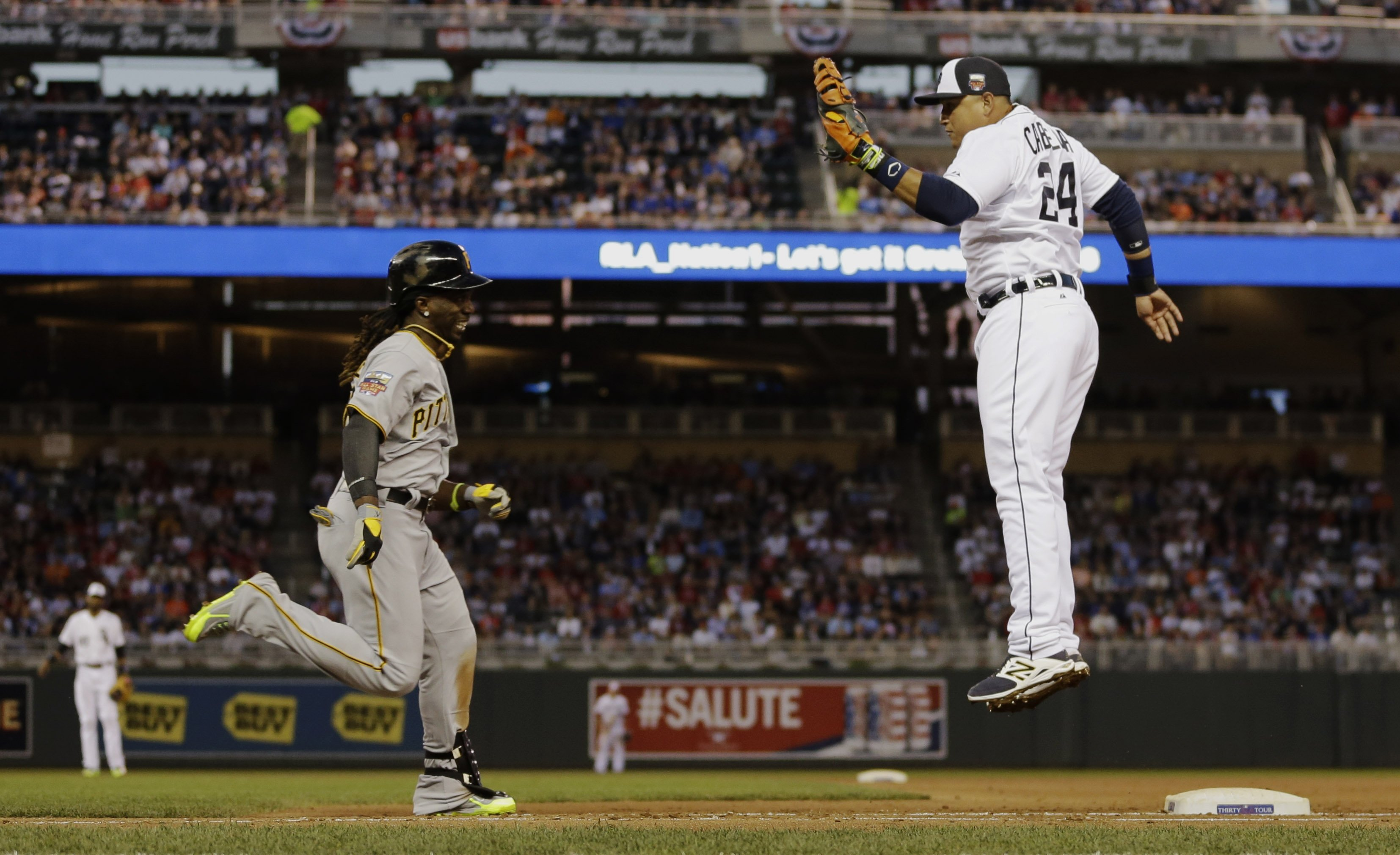 American League first baseman Miguel Cabrera, of the Detroit Tigers, tags out National League's Andrew McCutchen, of the Pittsburgh Pirates, at first base during the fifth inning of the MLB All-Star baseball game on July 15, 2014, in Minneapolis.